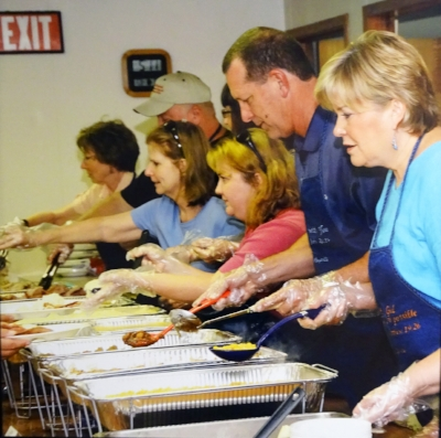 Christmas in July Dinner - Rev. Kathryn McNeely on the right