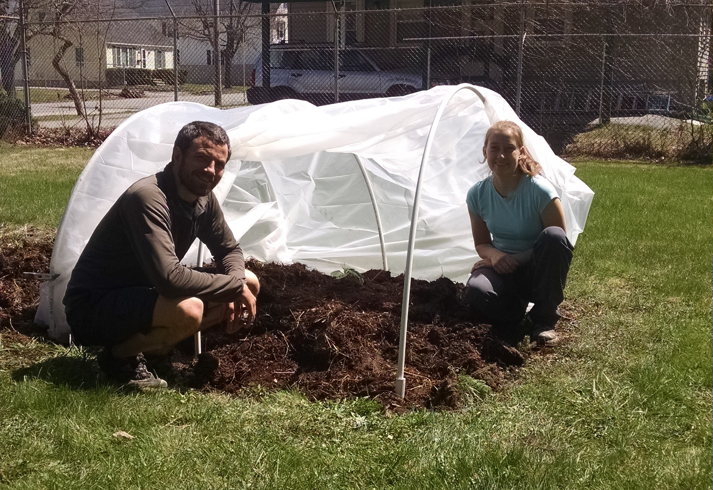 Posing with our seedling and hoop house at the Bangor Community Garden.