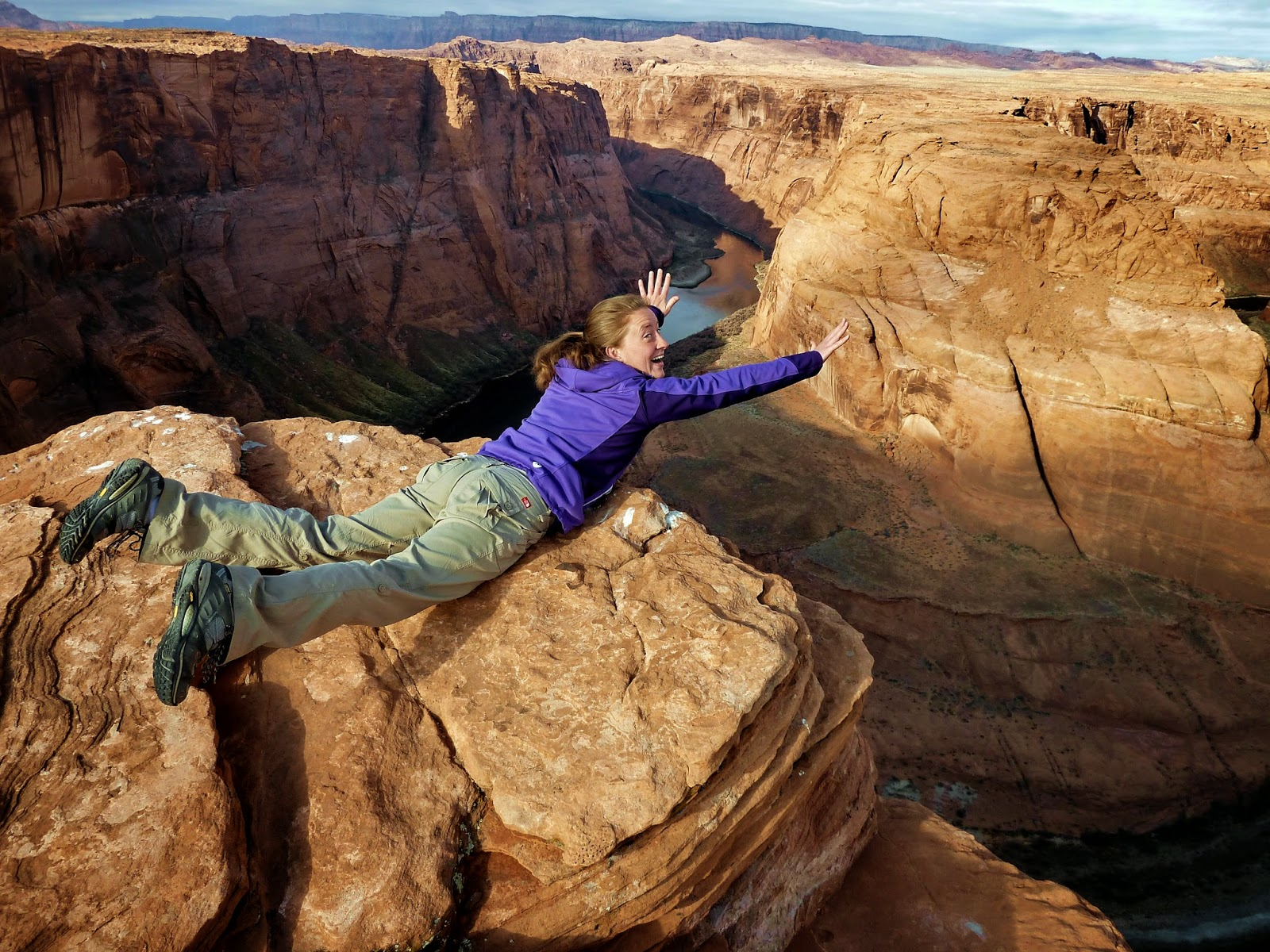 Hanging over the edge of the cliff at Horseshoe Bend in the Grand Canyon