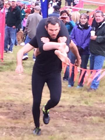 Dale carrying Sarah during the North American Wife Carrying Championship