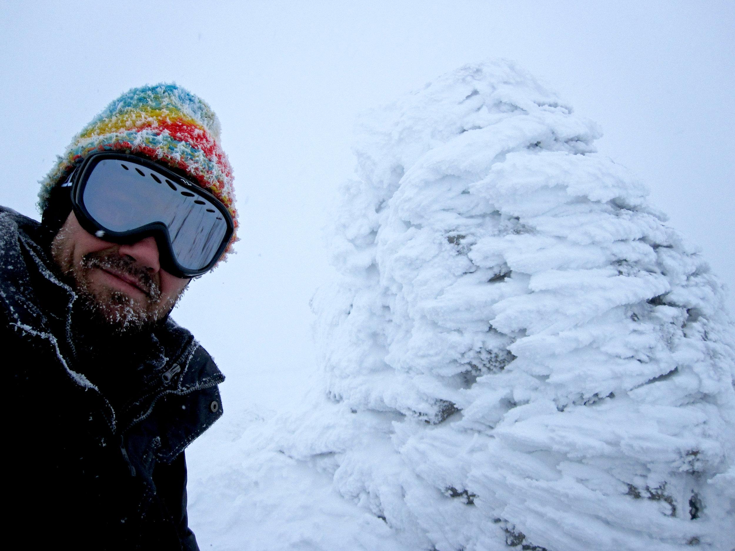 Mount Washington cairn with rime ice.