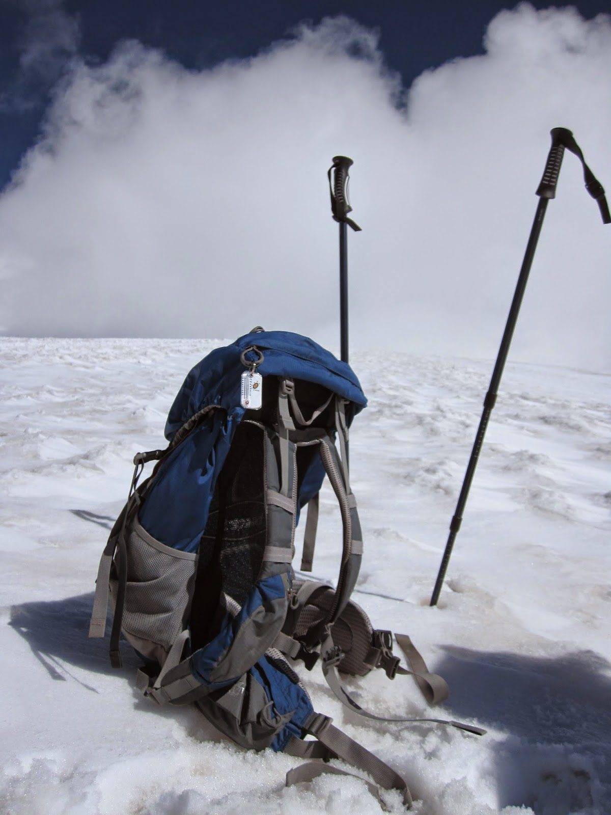 My backpack and hiking poles on Mount Elbrus