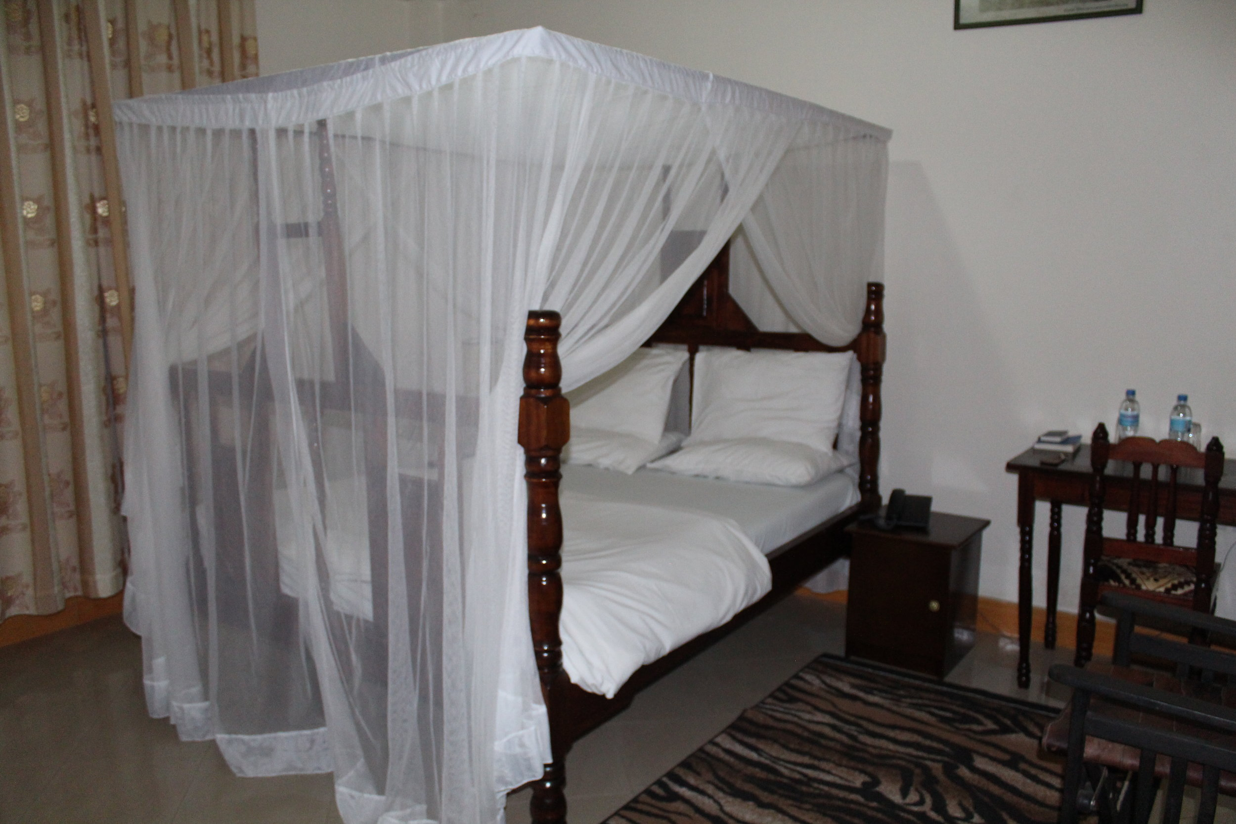 Our bed at Tumaini Cottage in Arusha.