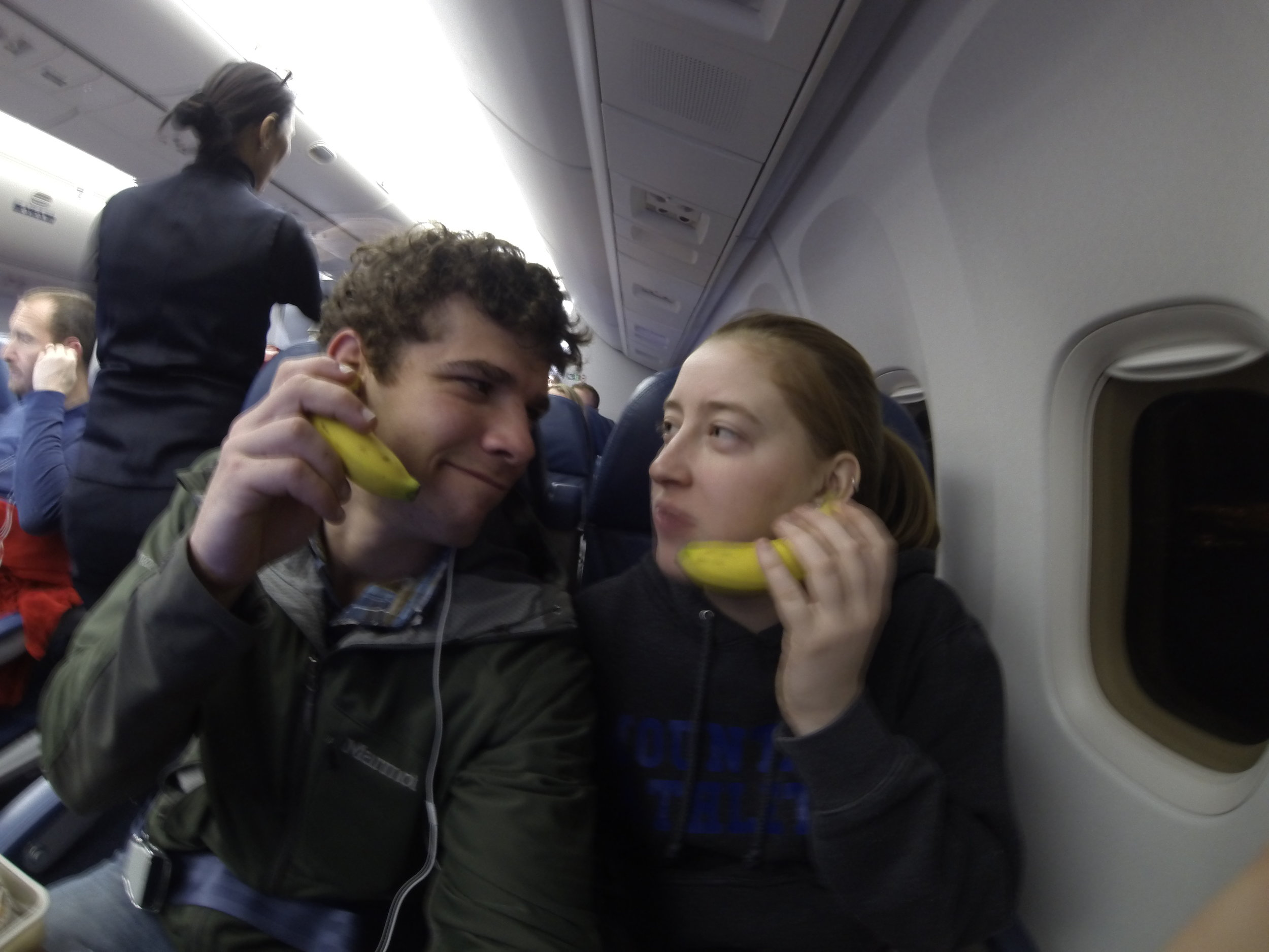 Playing with our food on our flight.