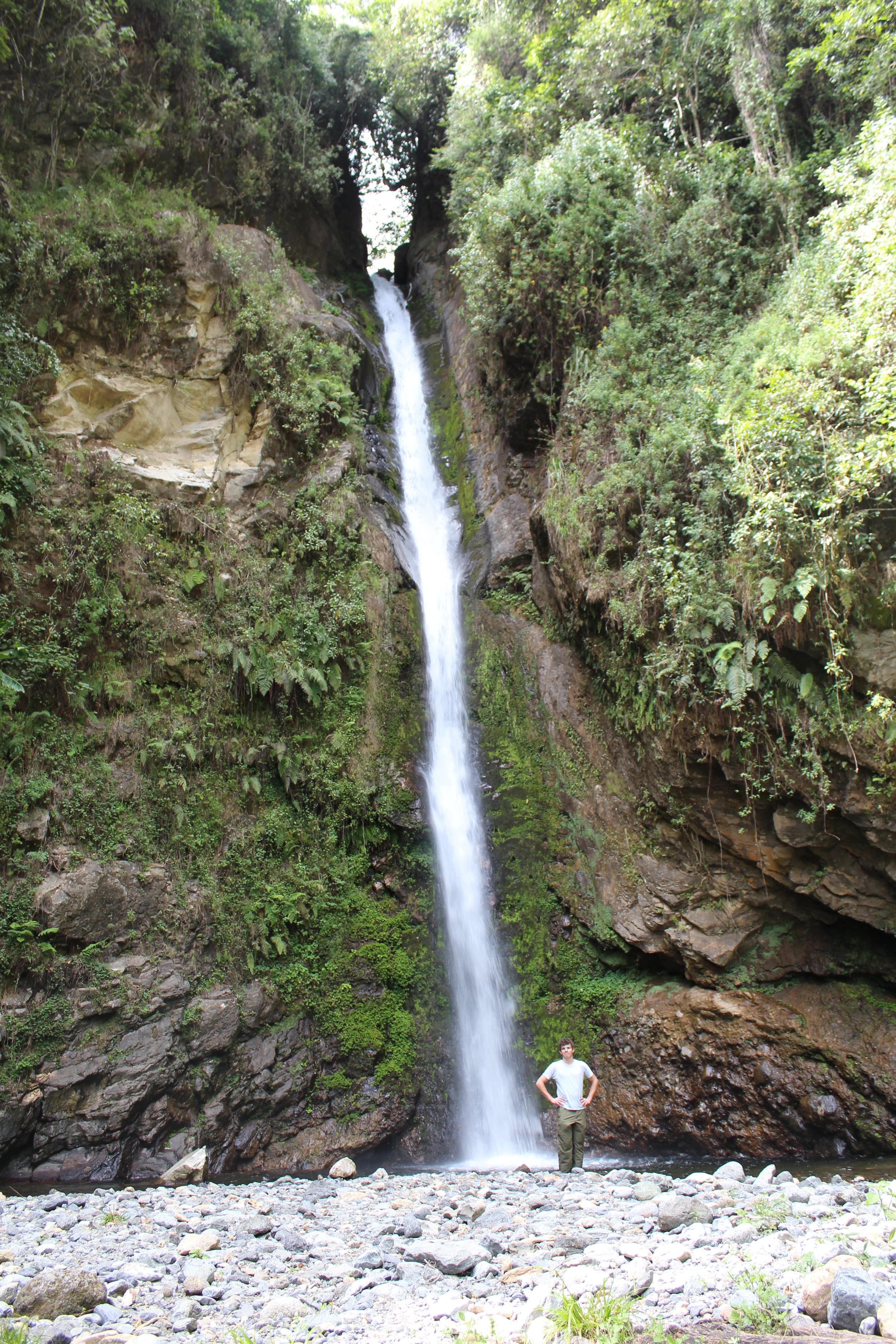 Pretty waterfall at the base of Mount Meru.