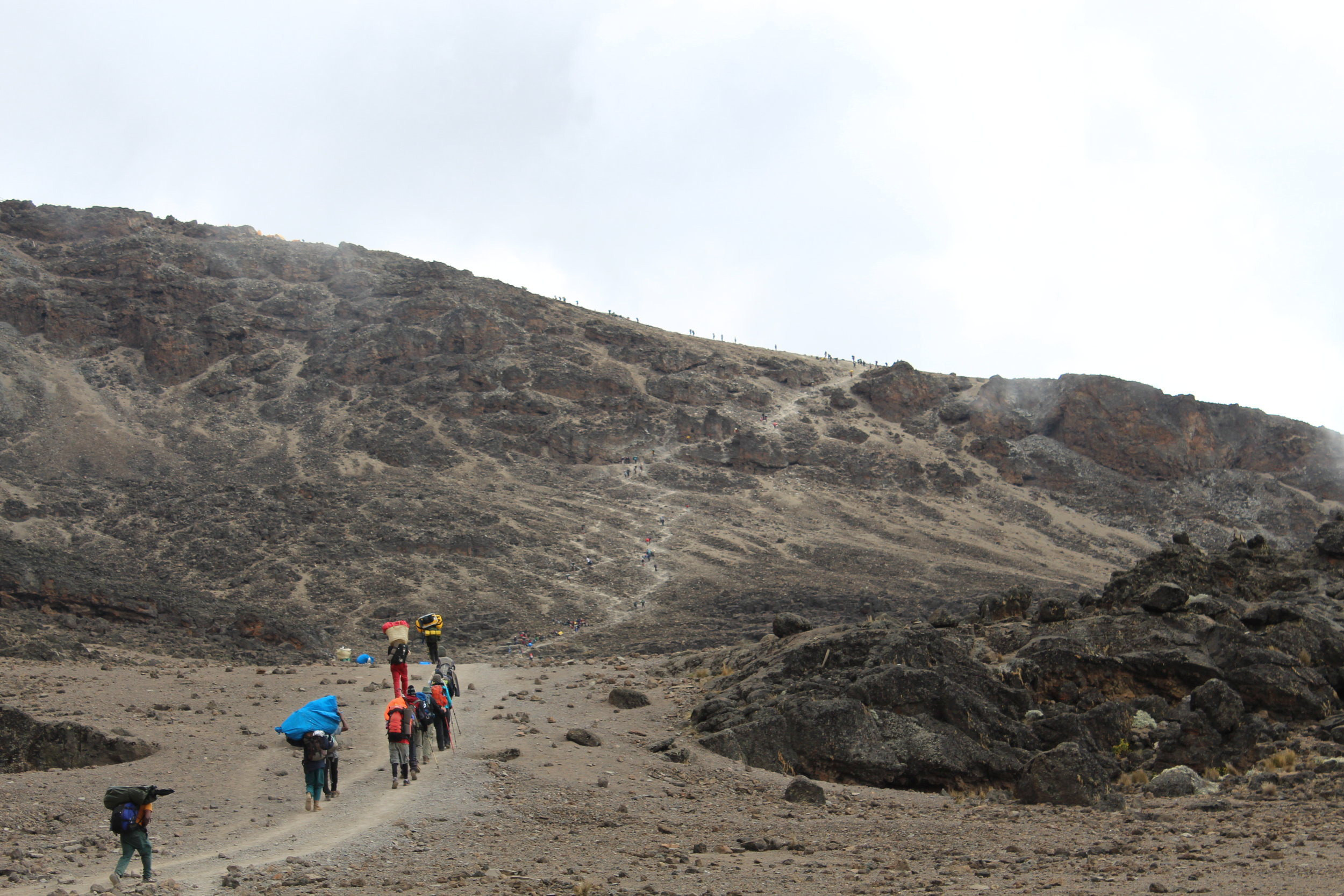 Porters making their way uphill to Barafu Camp