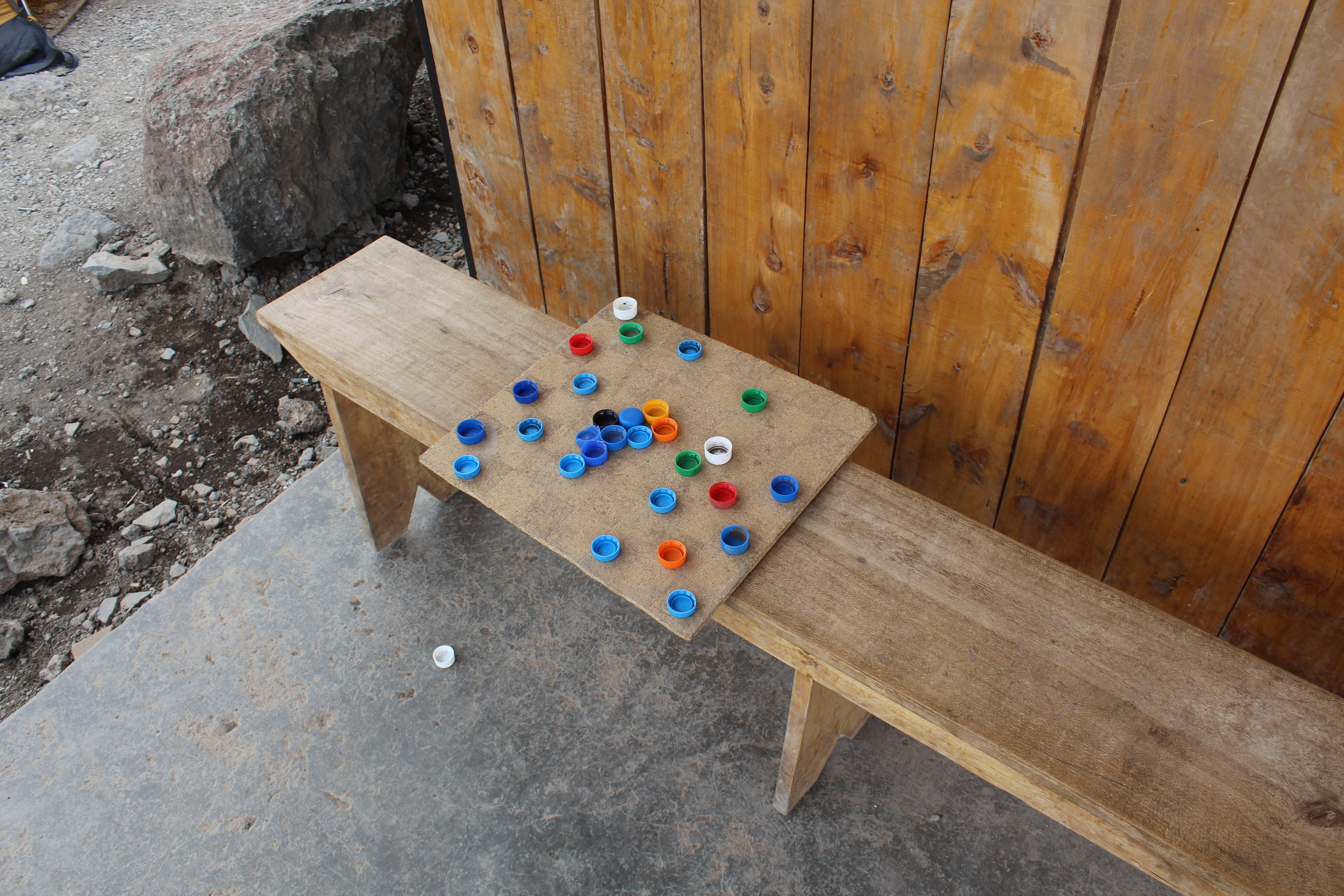 Checkers board with bottle cap pieces at Barafu Camp.
