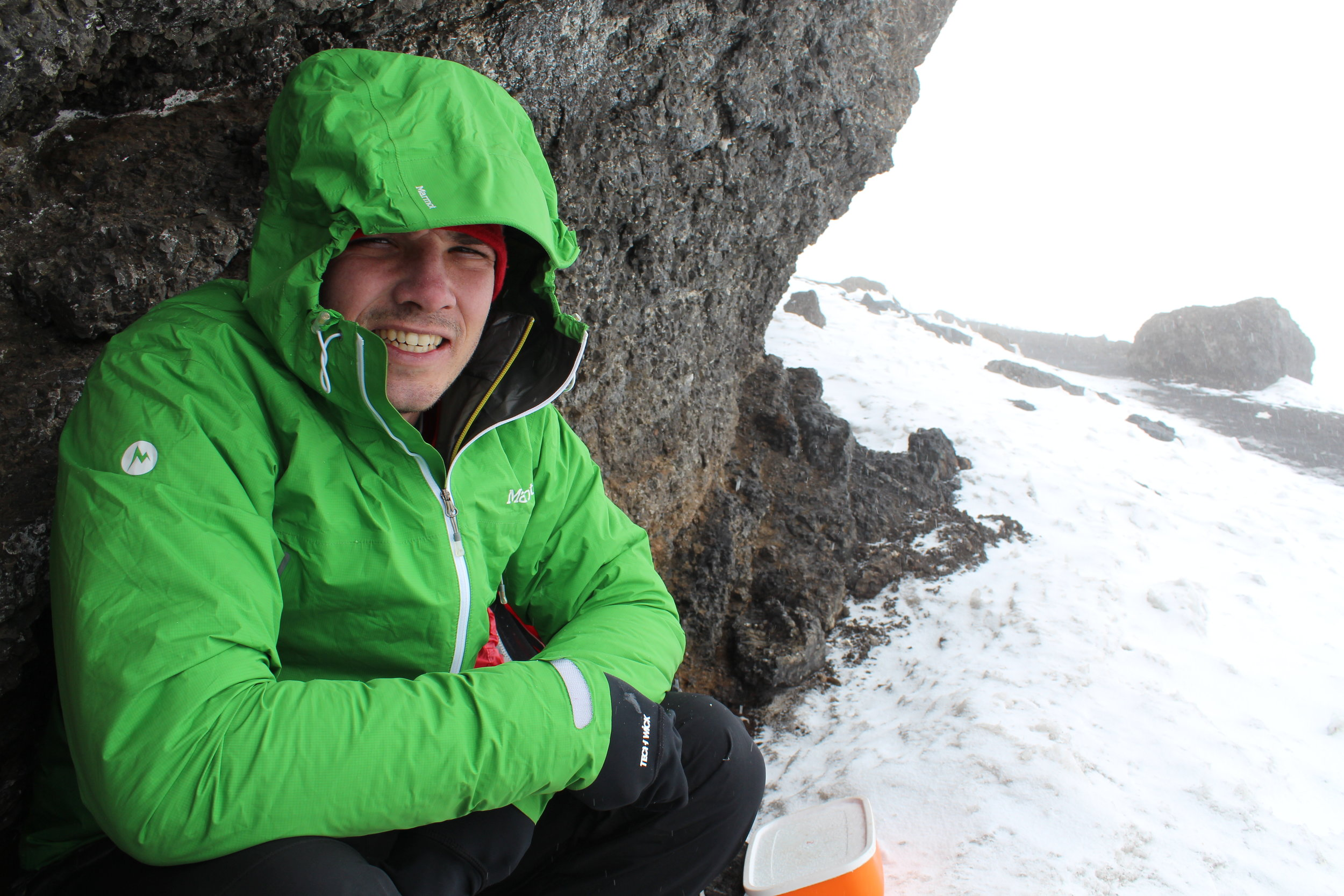 It was snowing and windy, so we hid under a ledge at Stella Point while we ate some food.
