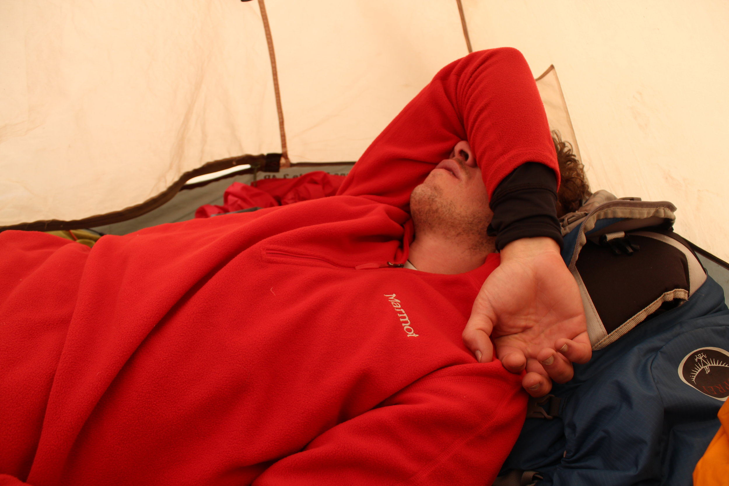 Charlie resting from altitude sickness in his tent