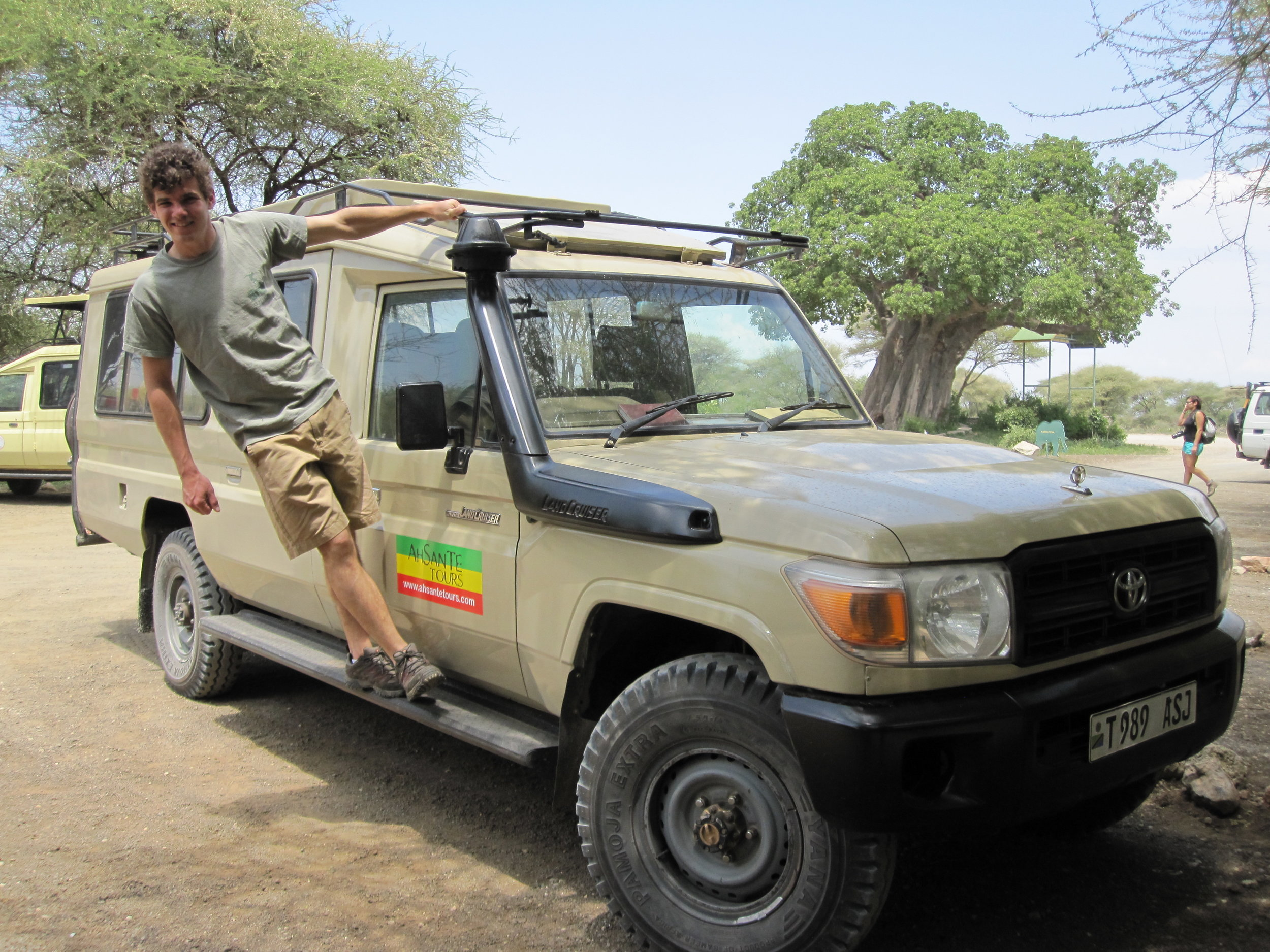 Playing around on our Land Cruiser on our safari with Ahsante Tours.