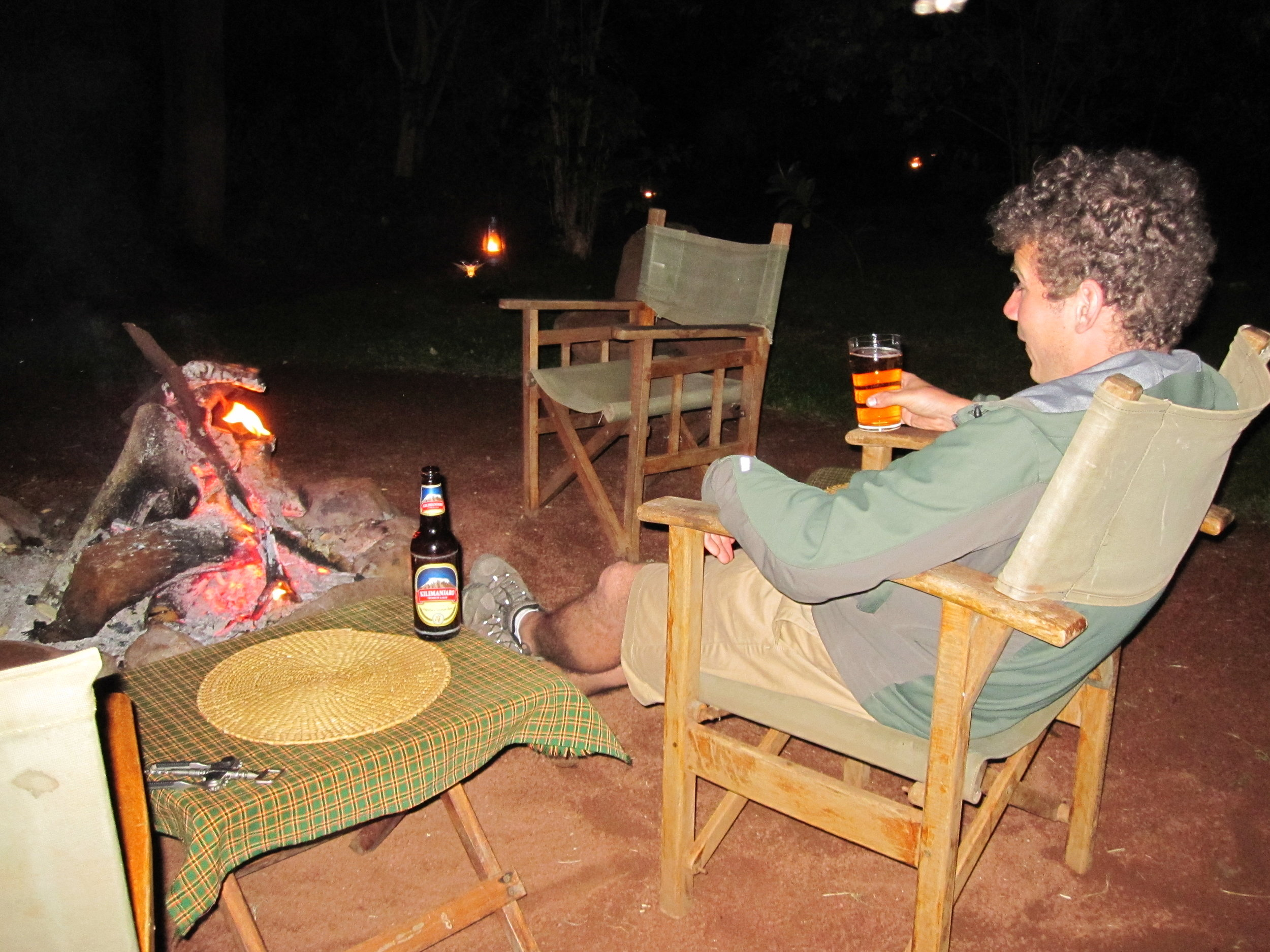 Beer by the fire on our camping safari