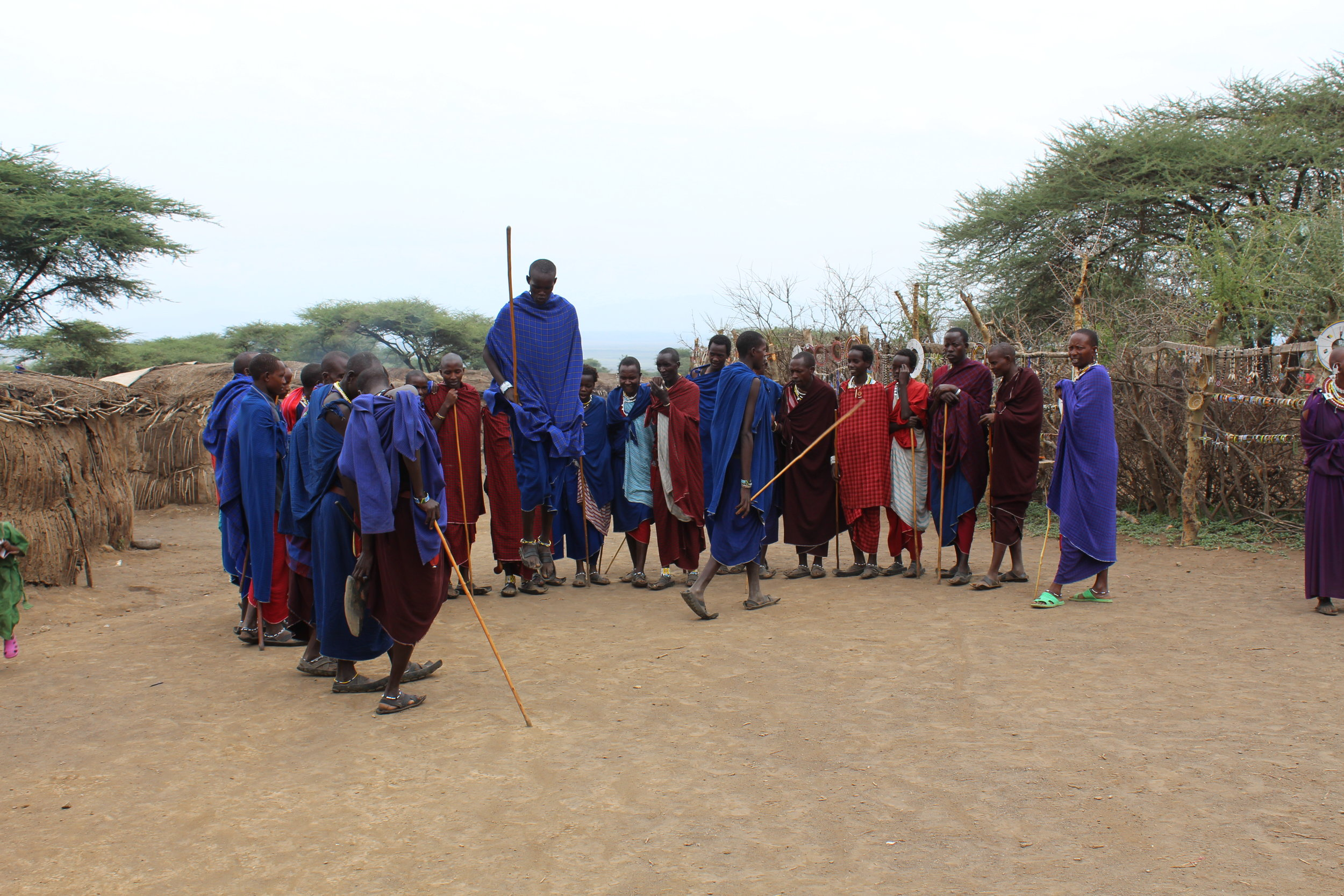 Massai men jumping during their ceremony