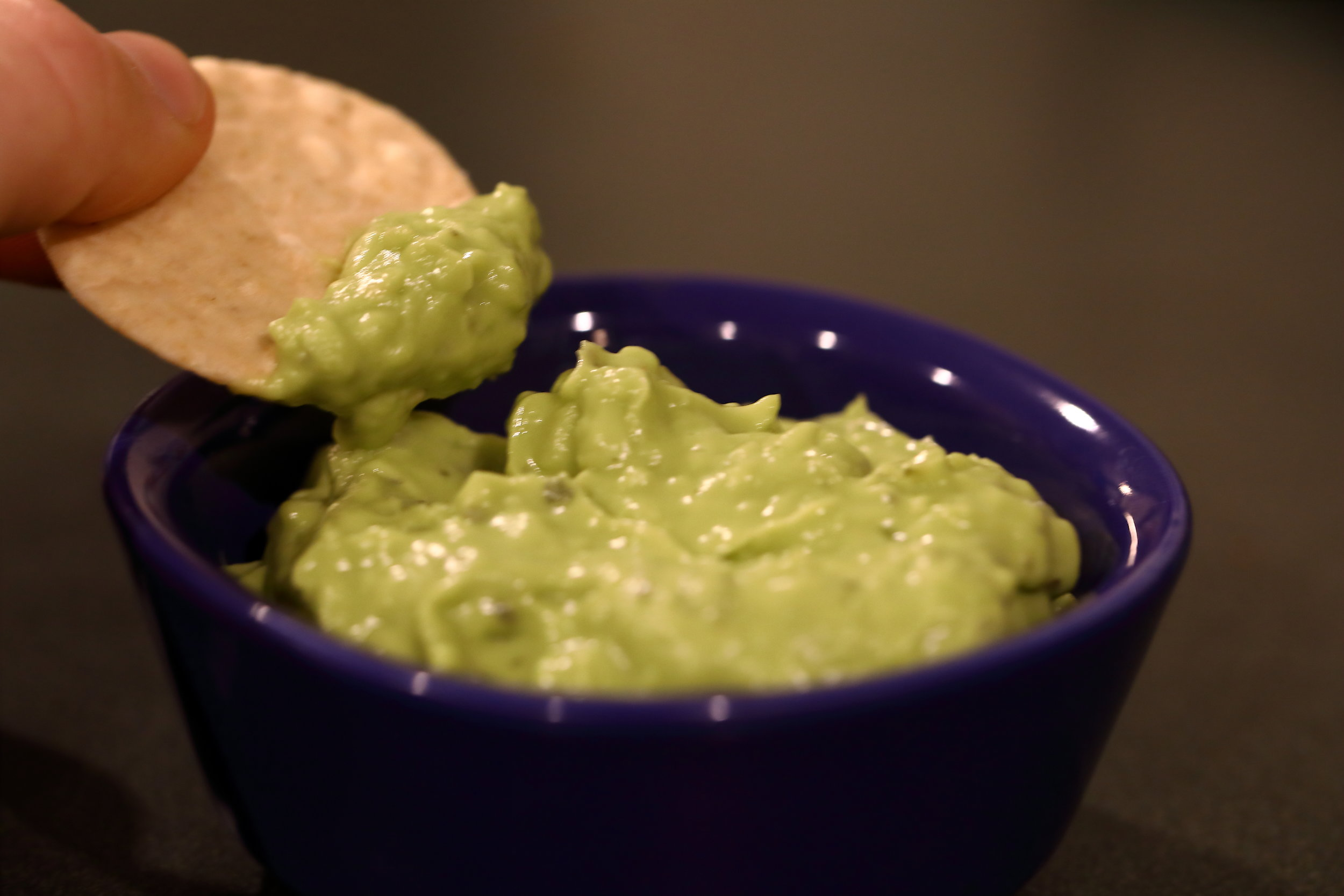 Healthy homemade guacamole with rice cracker.