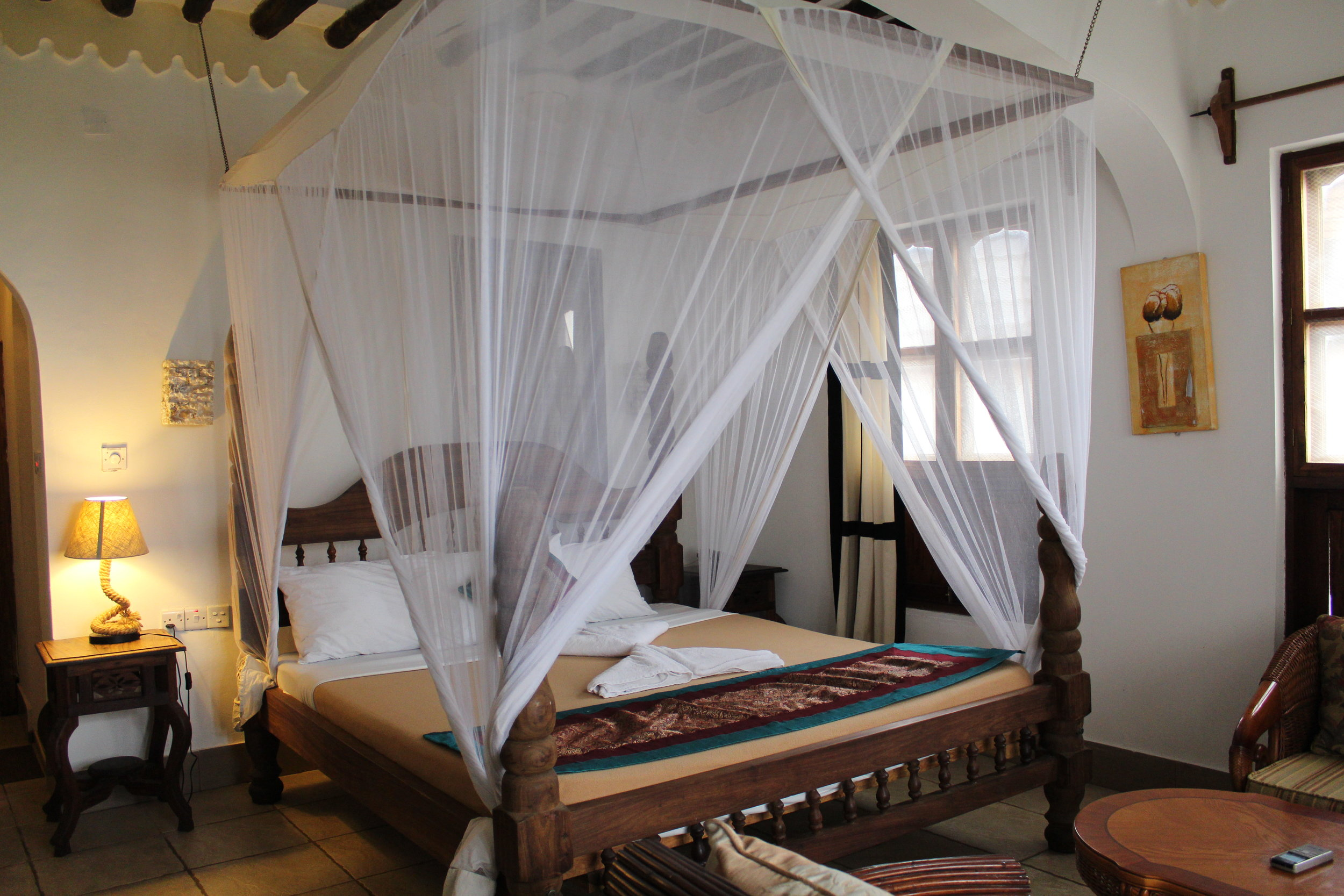 Our beautiful room and bed with mosquito netting at Langi Langi Beach Bungalows in Zanzibar