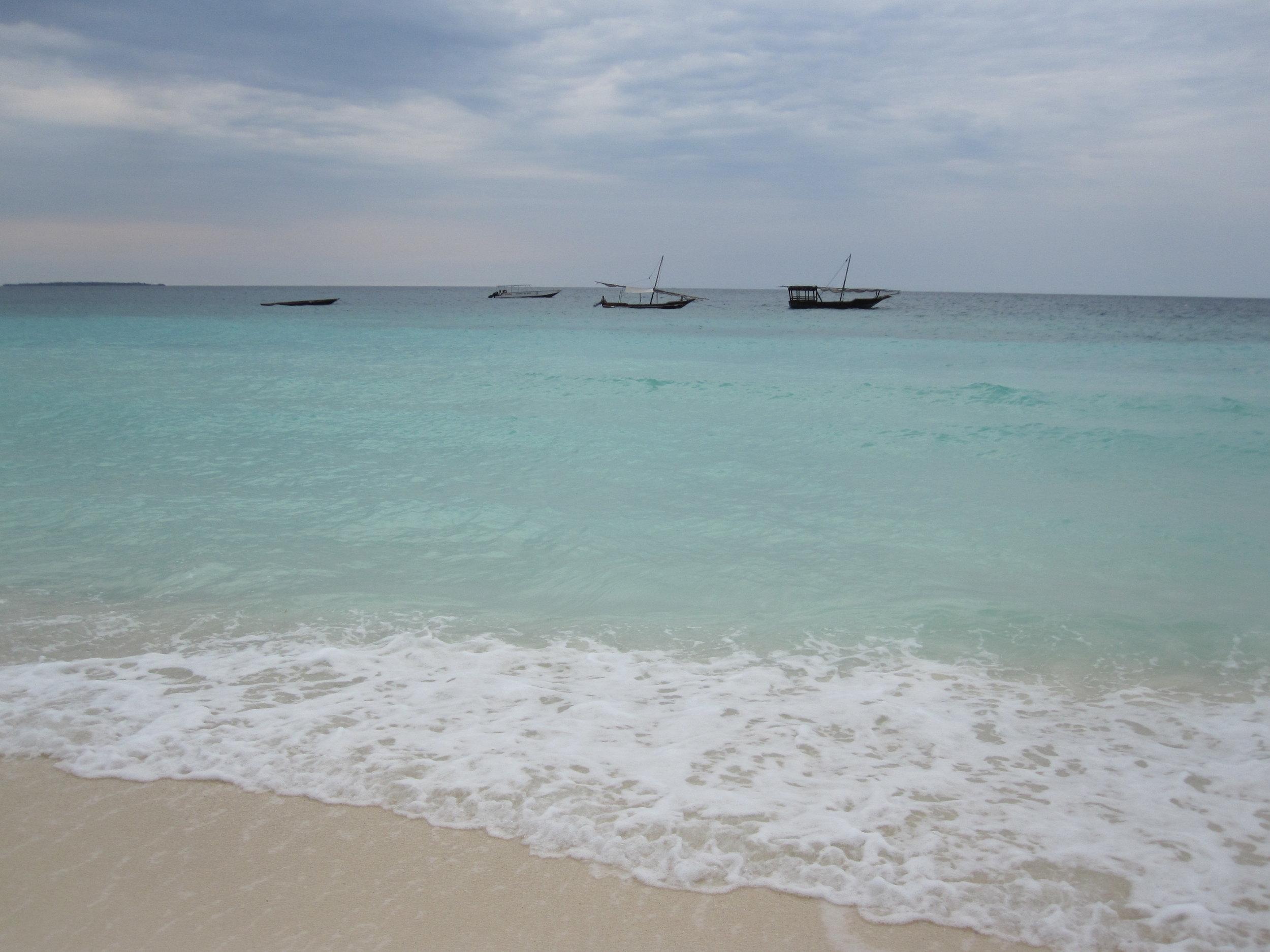Dhows in the water in Zanzibar
