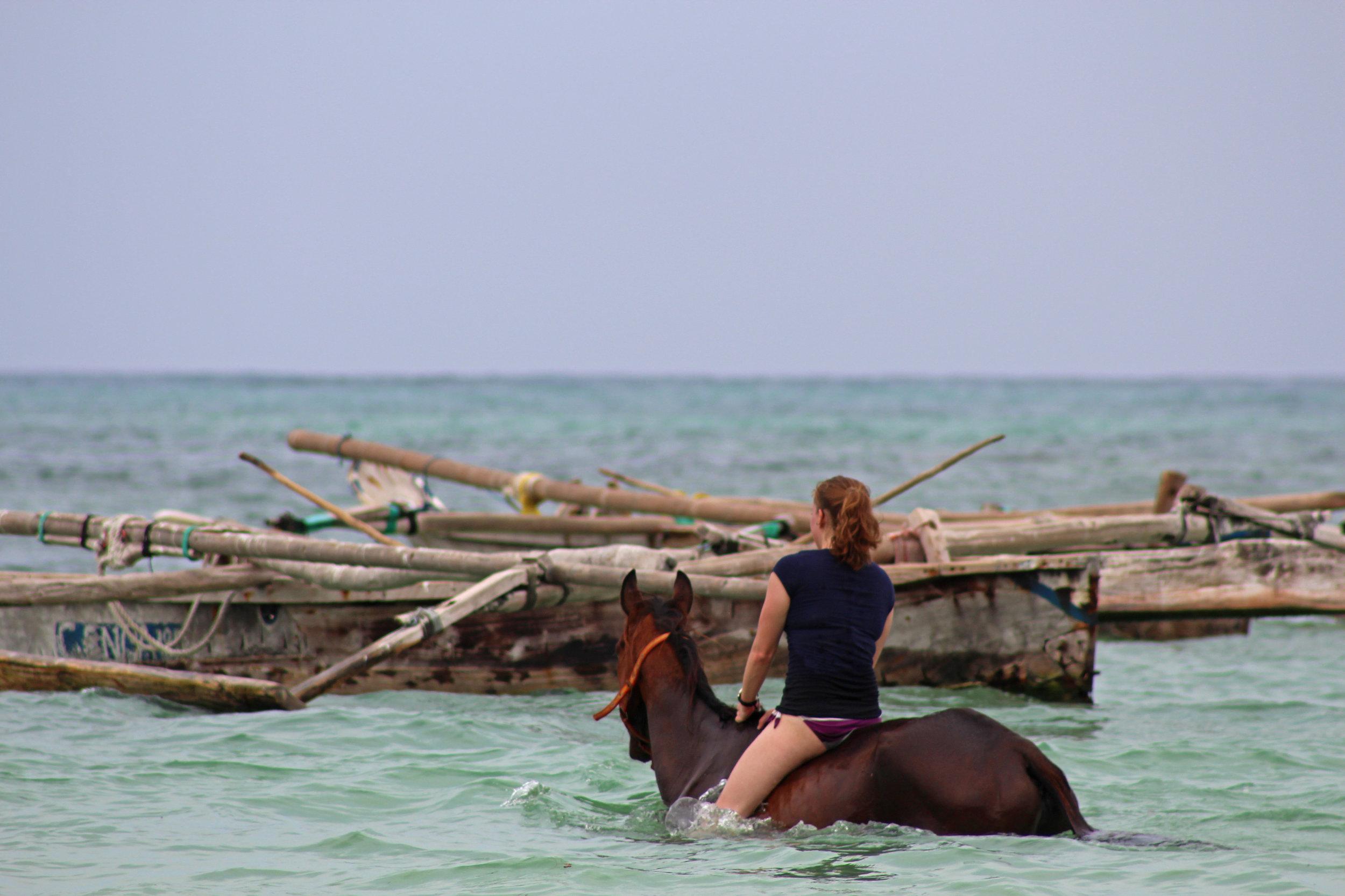 Bareback swimming on horseback in Kiwengwa, Zanzibar.