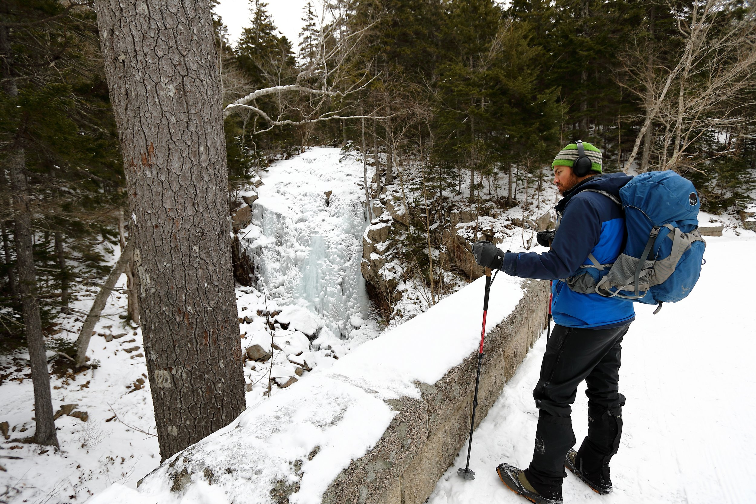 Enjoying the frozen waterfall on the carriage road before making our way up the Hadlock Brook Trail to the summit of Sargent Mountain.
