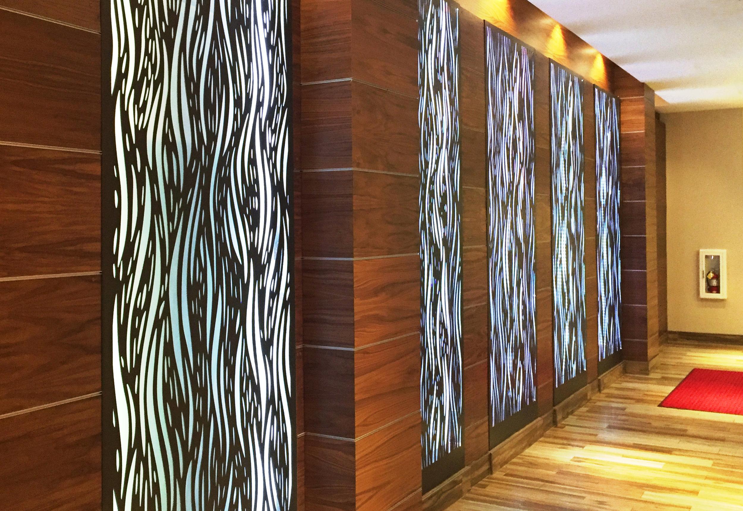 Hampton Inn San Francisco, CA  -Paradigm Construction  Waterfall, backlit panel