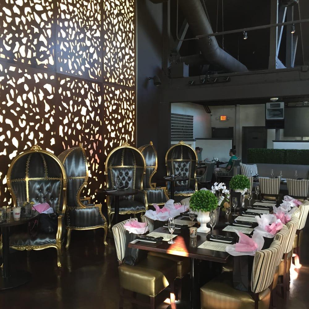 OPM Restaurant, Hunington Beach, CA  - Julie KhuuI Design  Dappled Light pattern, backlit wall partition