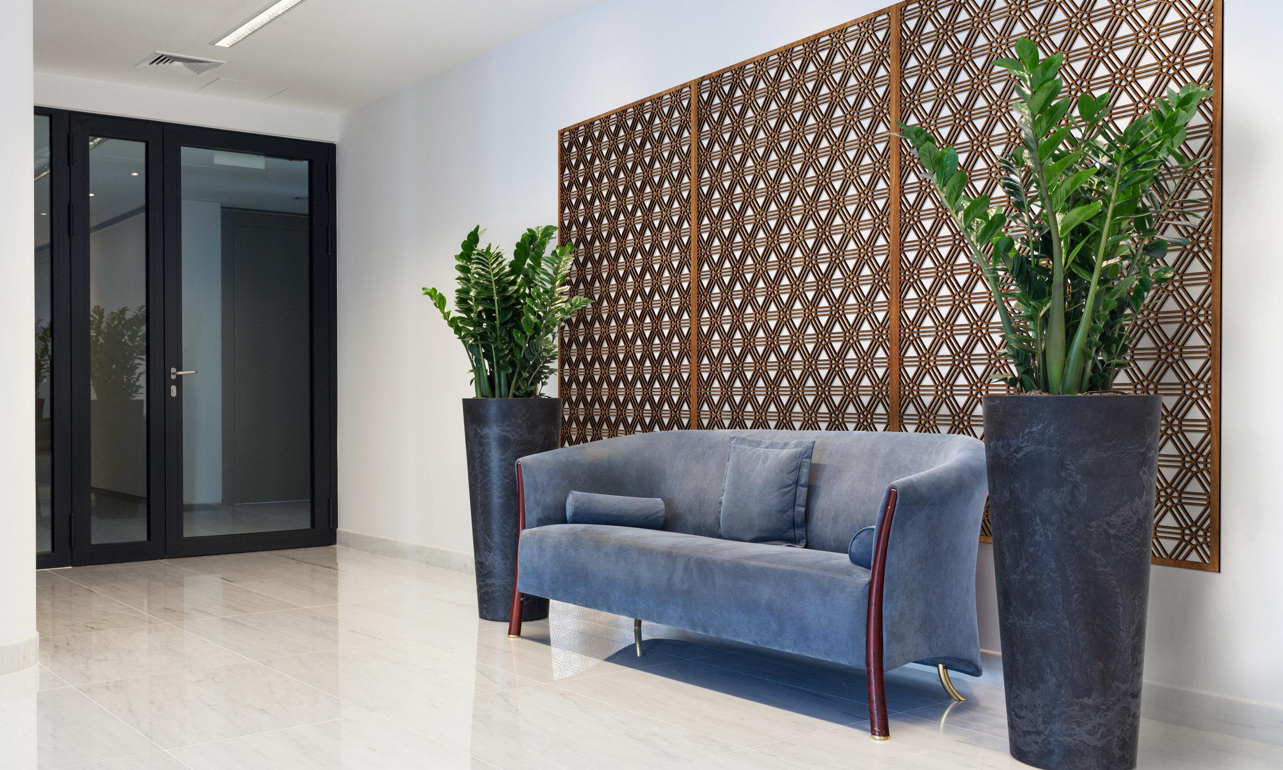 Installation Rendering A   Interlocking Wheels decorative office wall panel - shown in Cherry