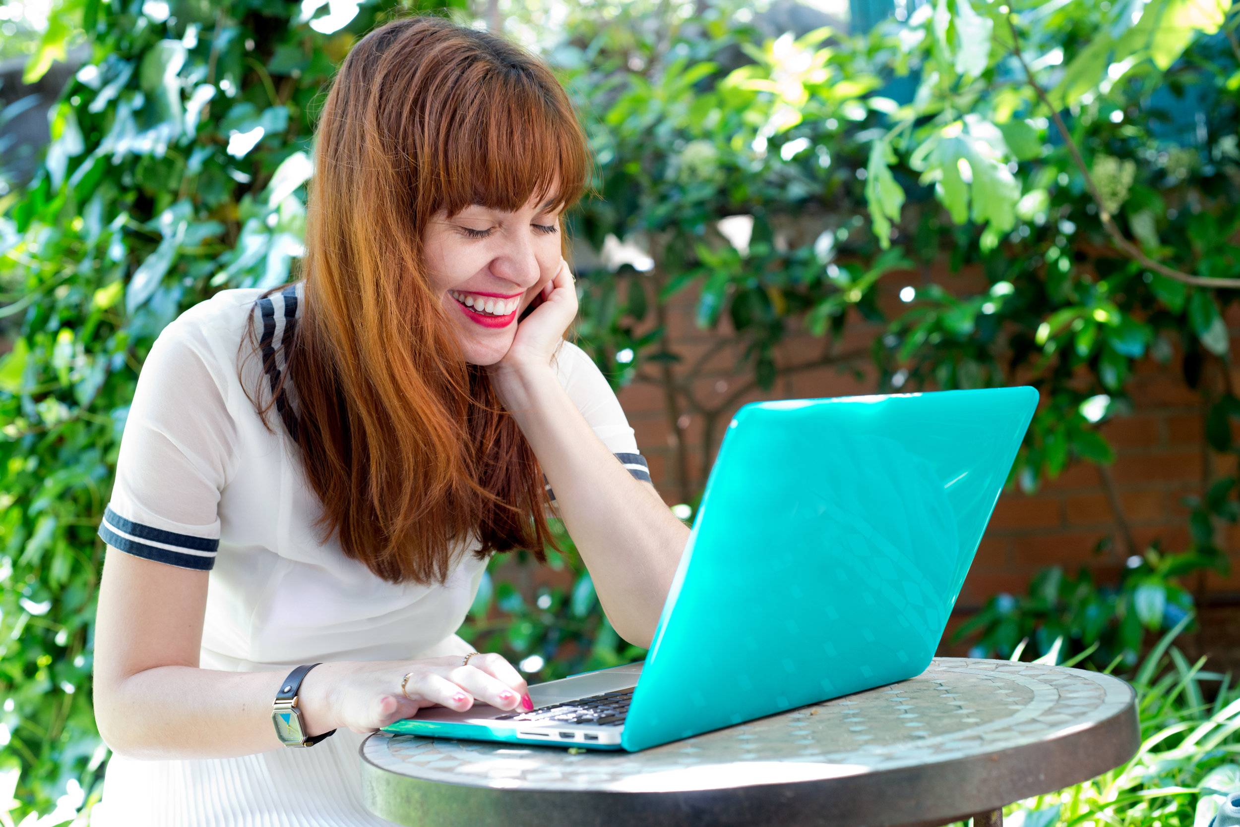 Laughing woman with laptop.jpg