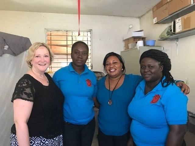 Dr. Wickstrom with lab technicians Marthe and Mirlande (in the polo shirts) and Rosena, the director of Maison de Naissance.