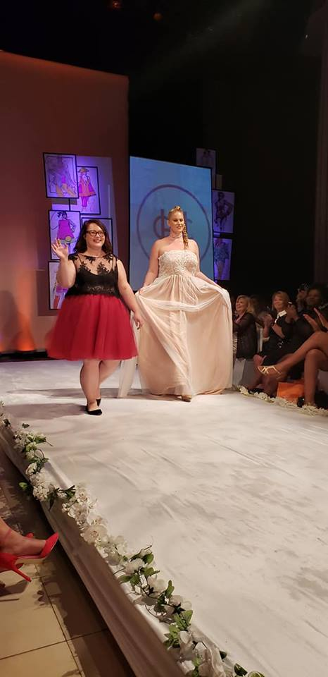 Hannah on the runway with one of her models at Full Figured Fashion Week, 2018