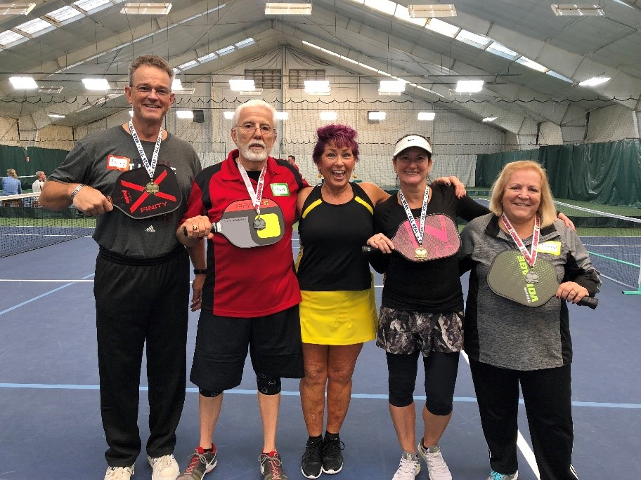 "Division ""C"" winners - 1st place male: Larry Gallmeier2nd place male: Mark EbreoMargo Chase-Wells, tournament director1st place female: Toni Siracusa2nd place female: Cheryl Gallmeier"