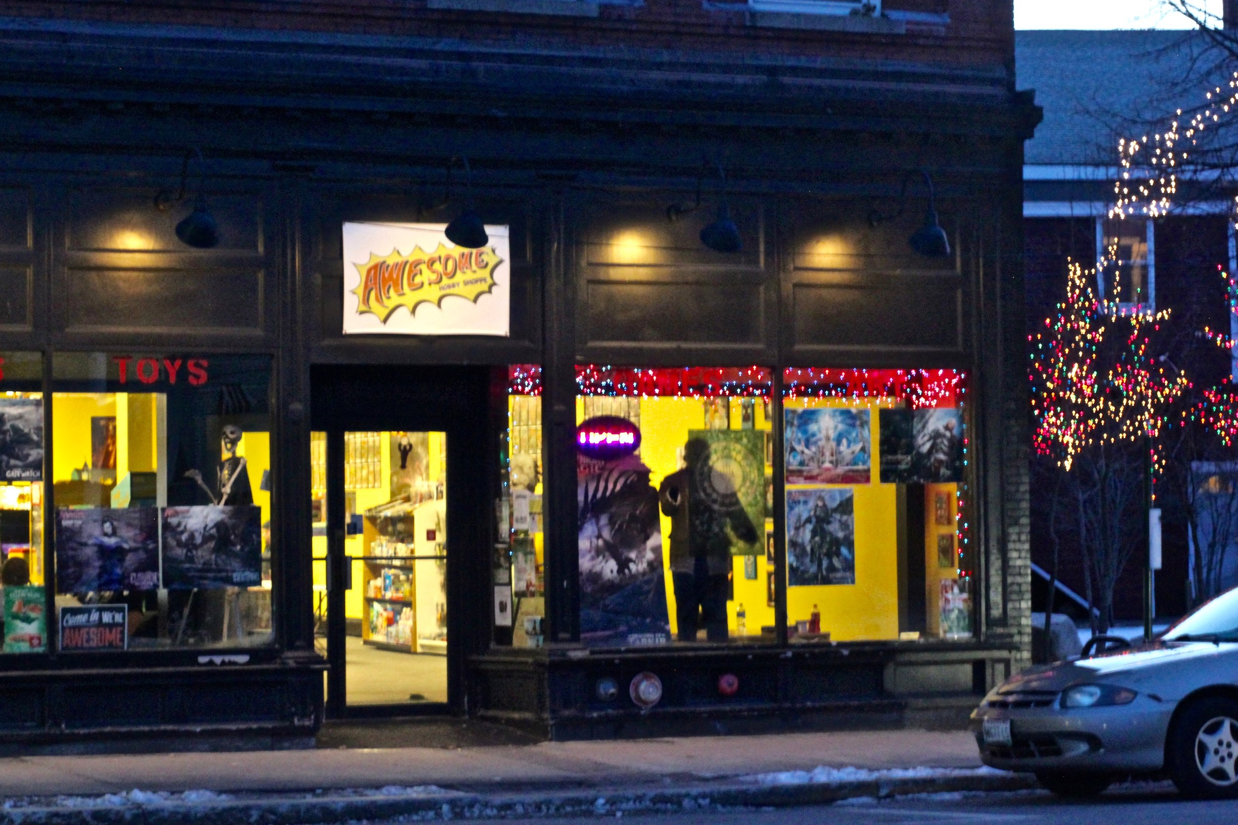 The exterior of Awesome Hobby Shoppe. That's a statue of Jason in the window.