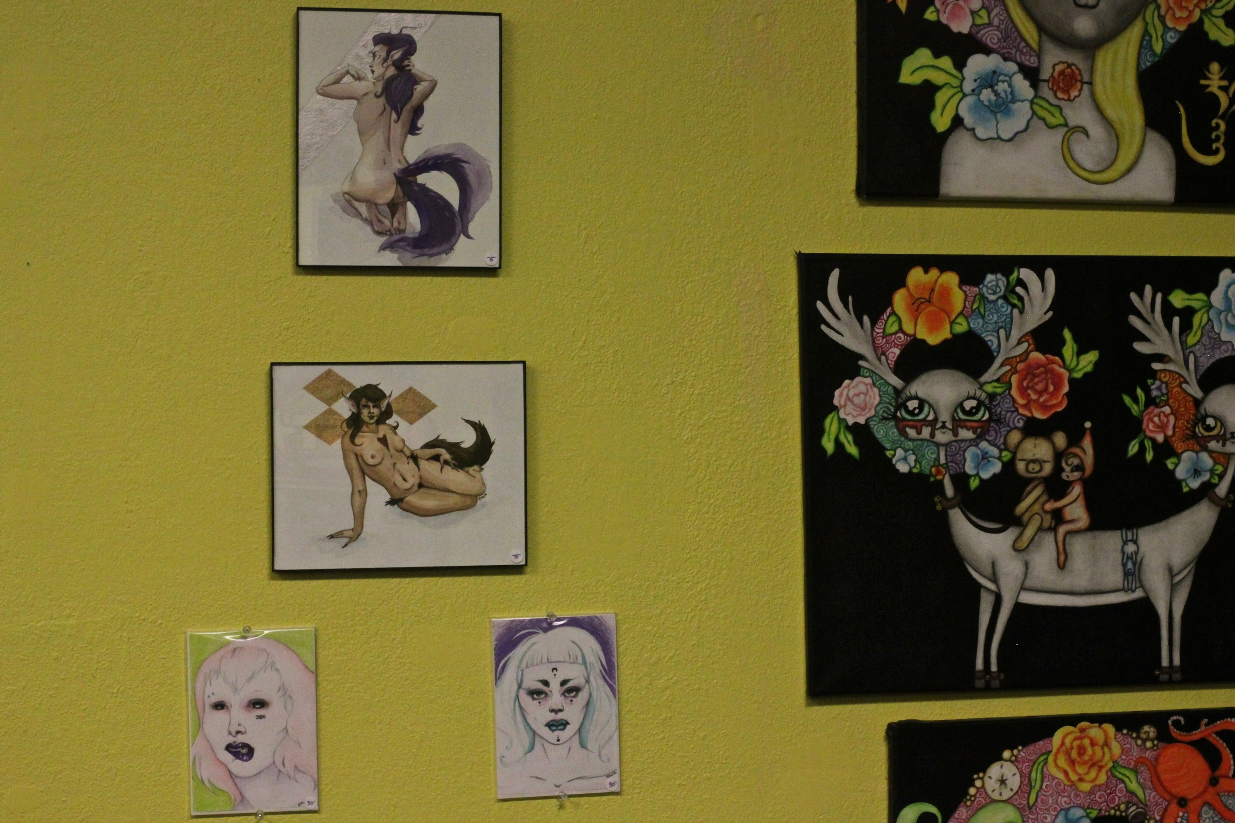 The artwork to the right of mine is by Elizabeth Carmella.