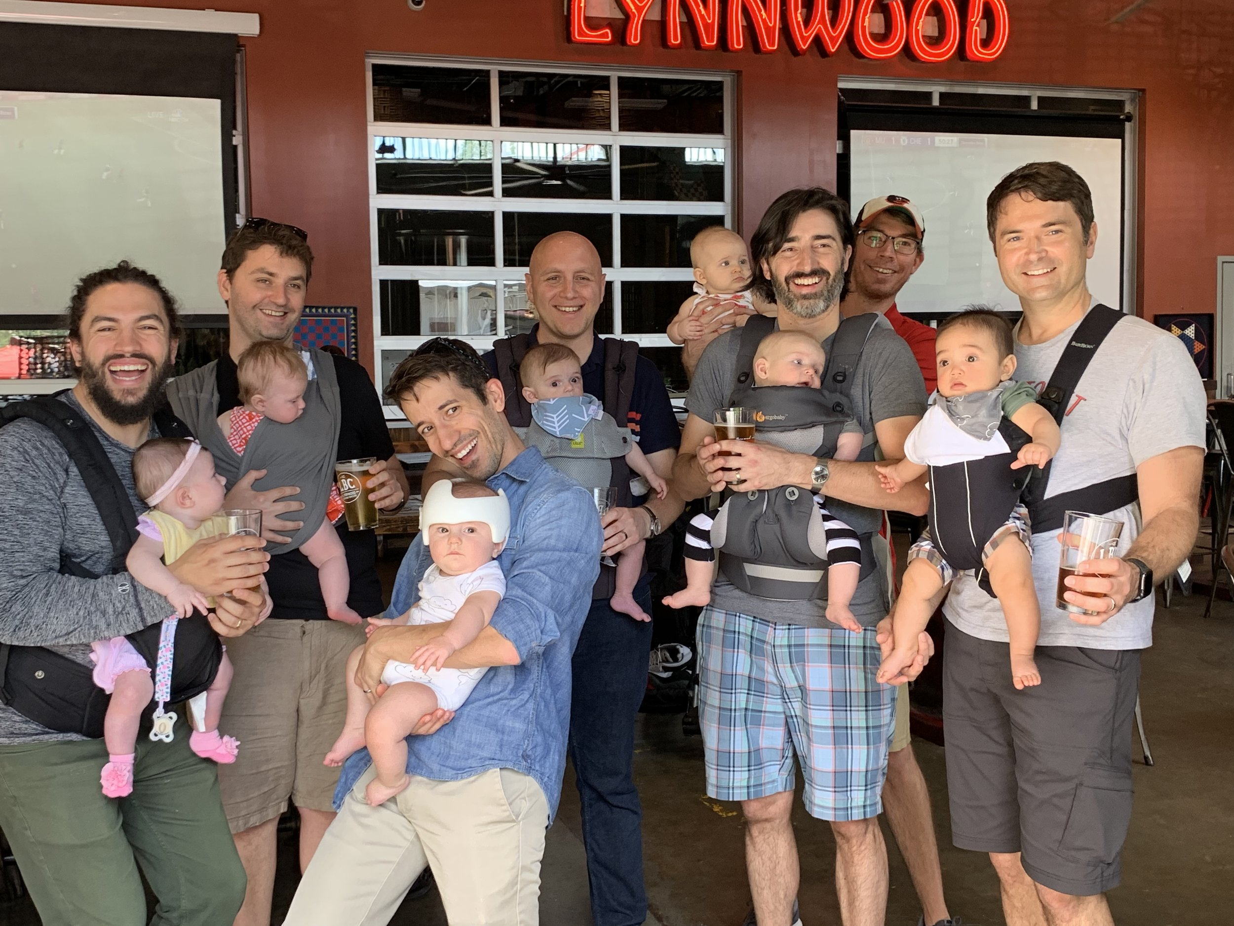 Dads can carry babies too! Adam Ness and Brian Chamberlain with the other Dads from their TAPS group at a recent family outing.