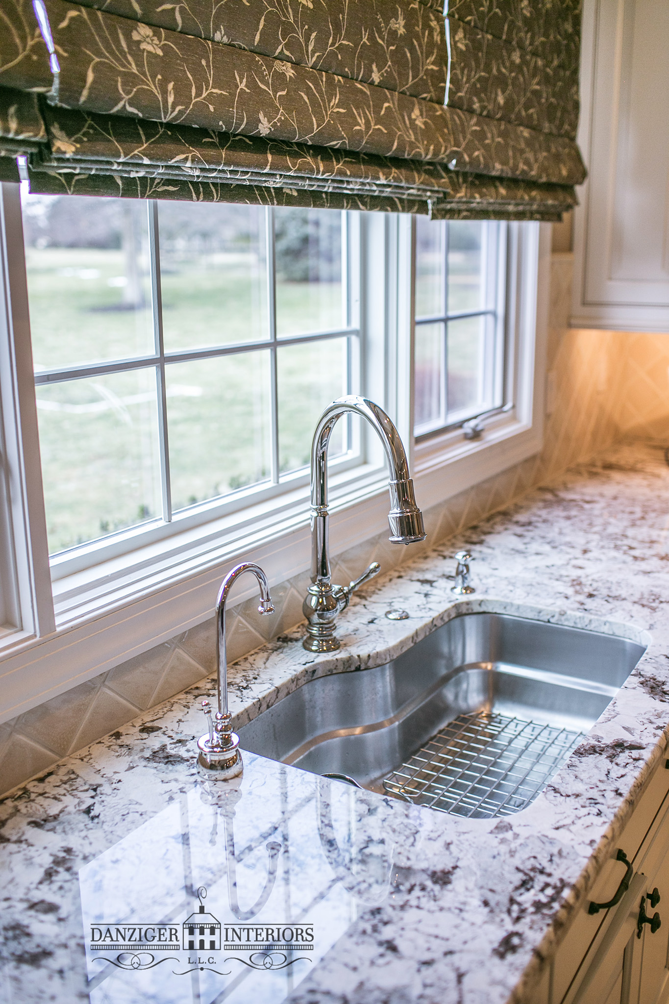 Stainless steel sink with hot water tap