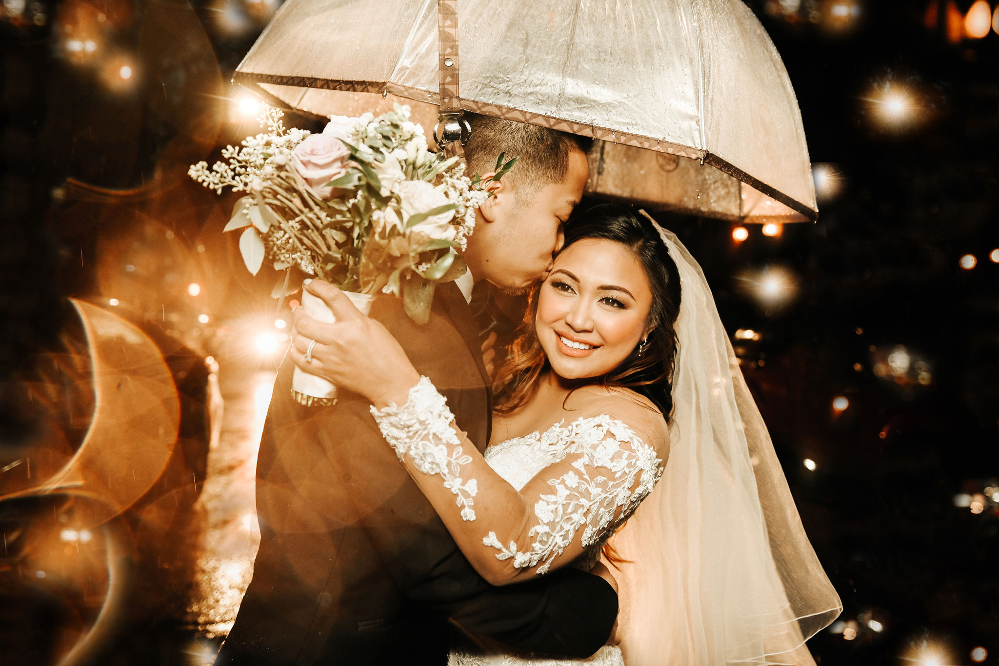 Karen & Calvin - The rain didn't put a damper on this beautiful New York City wedding. Click here to read more about Karen and Calvin's big day.