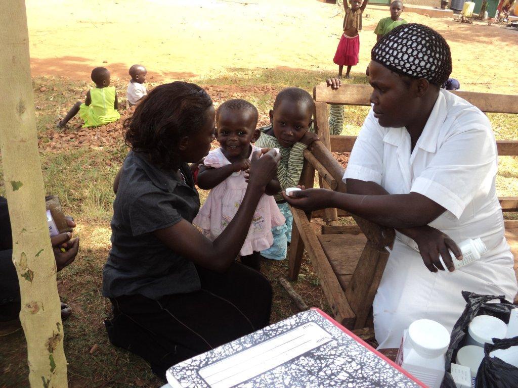 daizzy_administers_medicine_to_children.jpg