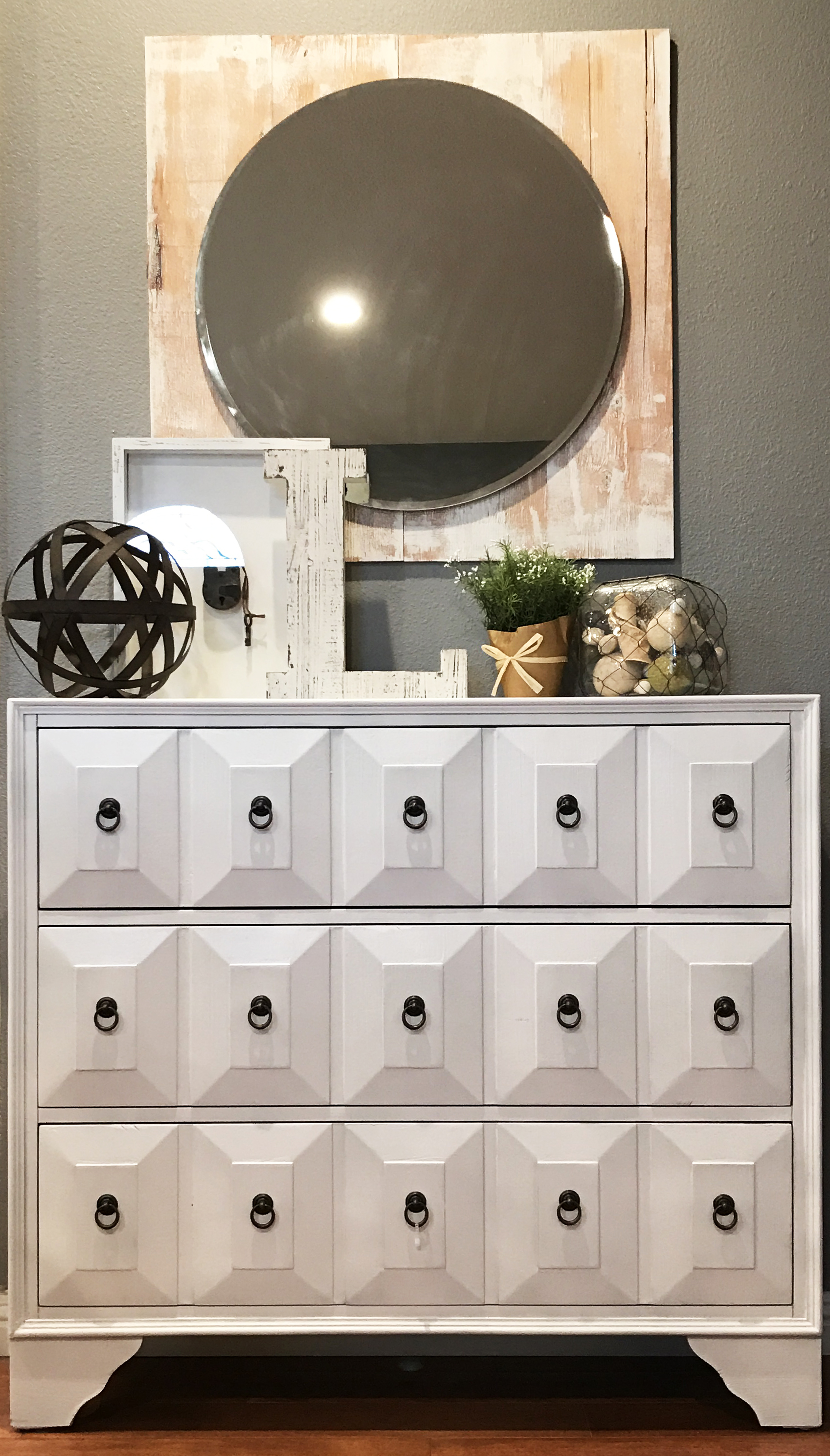 The mirror above the dresser is one of my favorite pieces in the Luna home.
