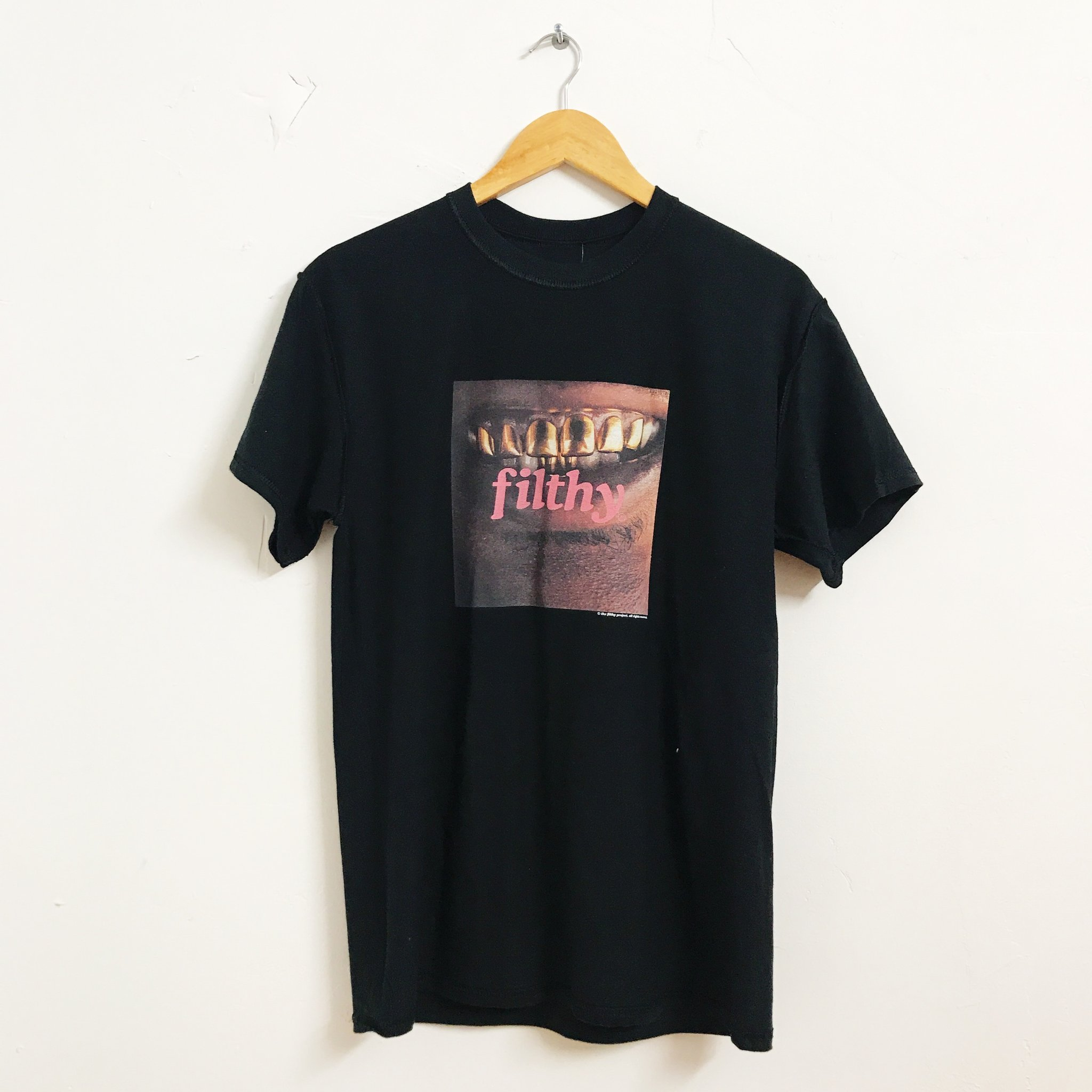 5. Eric's Gold Teeth Tee - Brand: Very Filthy ShitPrice: $25.00