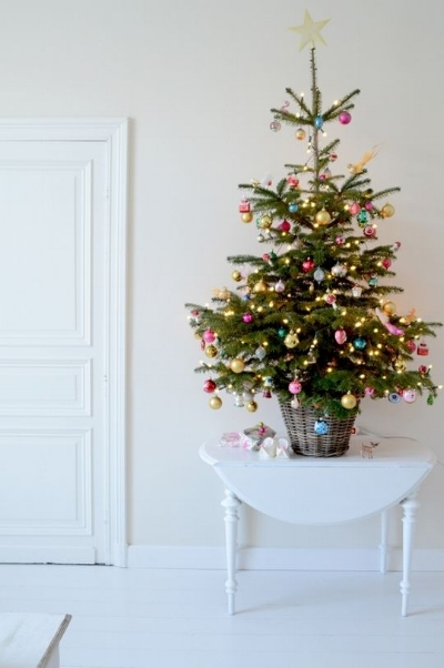 A lot of the time, having a Christmas tree in your hallway isn't always the most ideal situation. Your hallway can be a high traffic area that requires lots of space - but there's nothing like entering a home during the holiday season and seeing a beautiful Christmas tree greeting you as you walk in! Not everyone has the space for a big tree but you can have a smaller tree which can add just as much impact! Christmas trees come in all different shapes and sizes so see which size works best for you and have some fun decorating it!