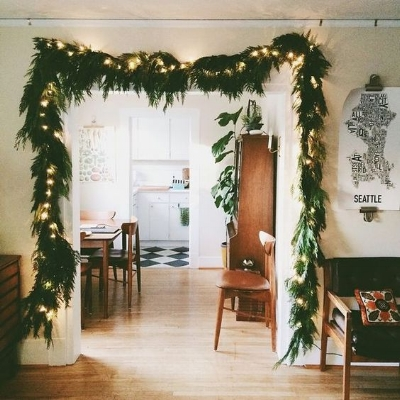 I absolutely love putting garland around doorways. Garland has a way of creating a beautiful picture frame look around the doorway of the room you're walking into. It gives a very magical, Christmassy feel while adding a natural element that dresses up your hallway for the holidays!