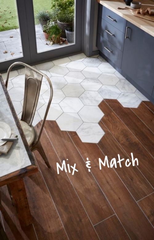 There is no rule in design that says you can't mix & match tile in a space. Use a combination of tiles in different shapes and sizes to go with your hex tiles – rectangles, squares, etc!