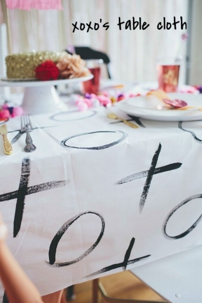 Looking for a Valentine's Day table cloth? Why not make your own! Get a plain white table cloth (fabric or plastic) and lay it out flat! Use markers or paint to draw X's & O's on the cloth! It makes for an awesome centrepiece!