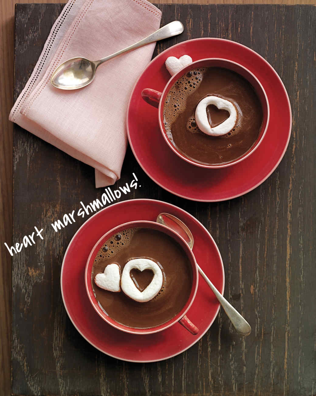 Here's a quick way to add some lovin' to your hot chocolate! Grab some large marshmallows and chop them in half. Get a sharp knife and cut out a heart in the center of your marshmallow - Place both cut-outs in your hot chocolate and you're good to go