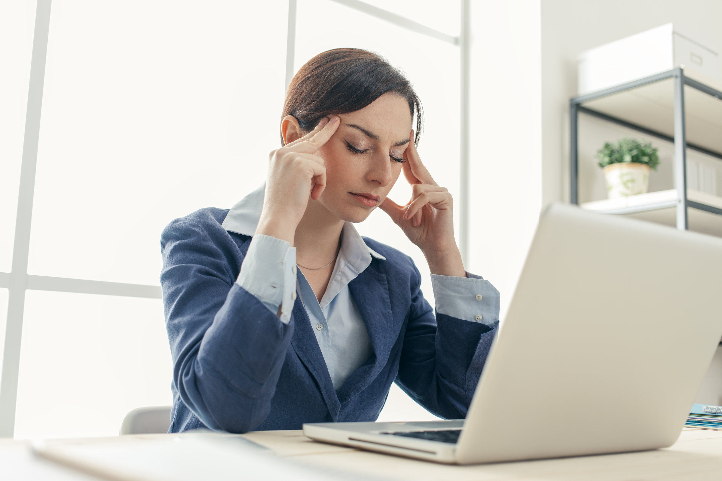 exhausted-businesswoman-at-work-PZWPTBL.jpg