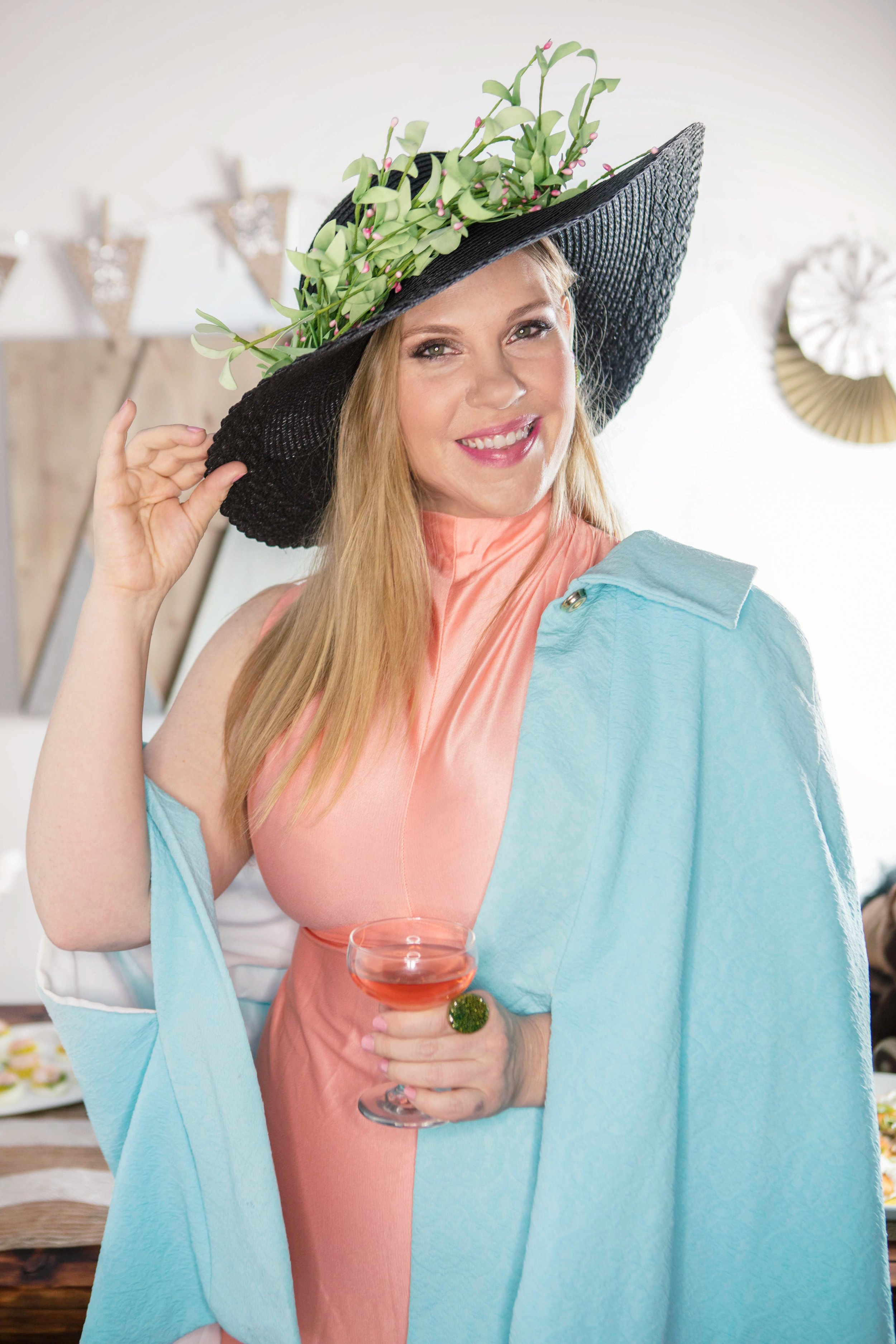 Sommelier Sarah Tracey of The Lush Life, modeling Kentucky Derby Party outfit ideas