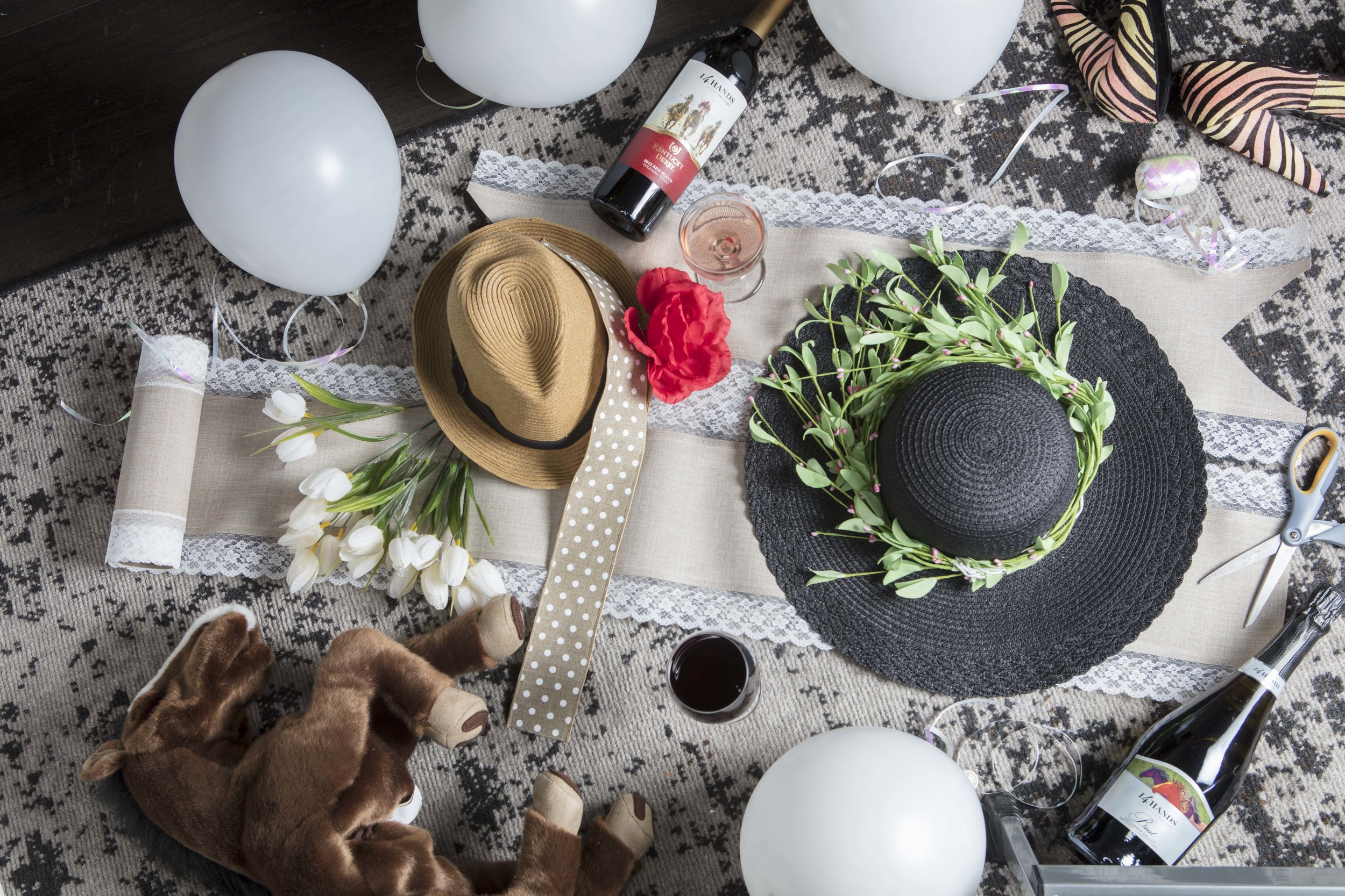 Create a DIY hat station so your guests can make a souvenir for your Kentucky Derby Party favors.