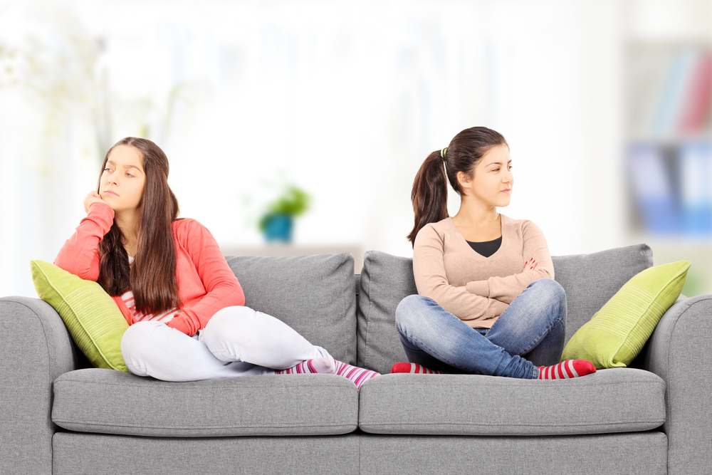 two sisters facing away on couch.jpg