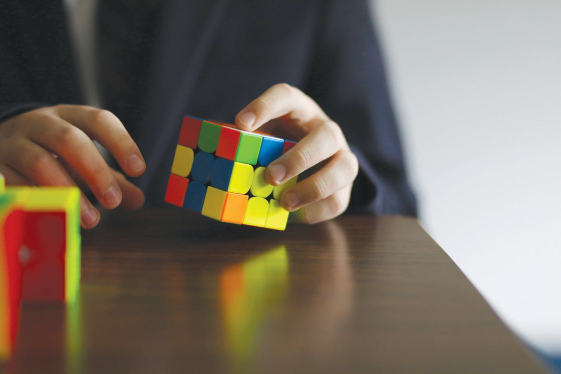 student-hands-cube-puzzle.jpg