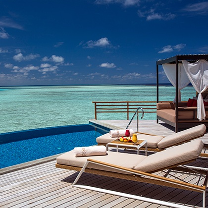 Baros-Maldives_Pool-Water-Villa-Deck_HR.jpg