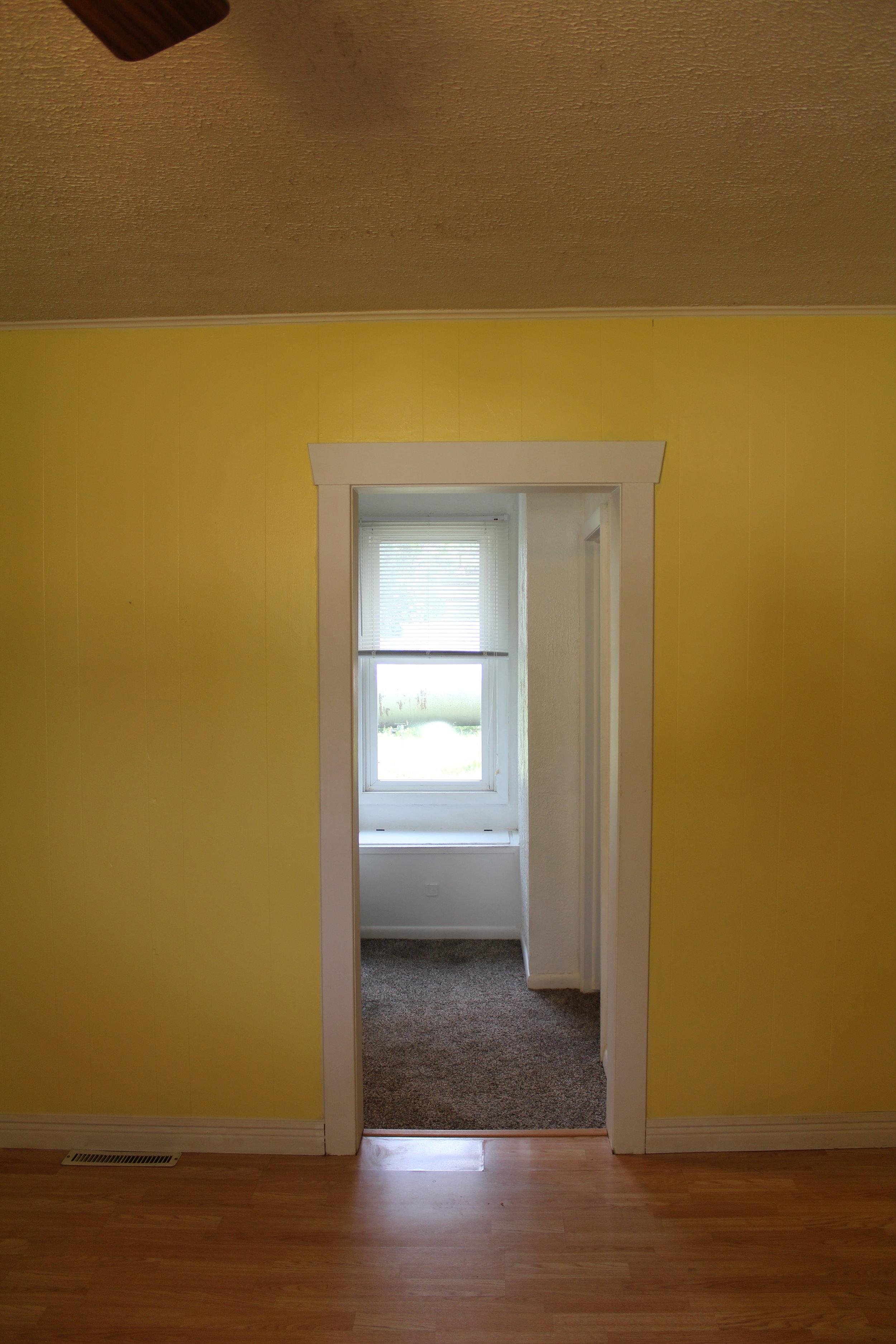 The hallway before....hello yellow walls!