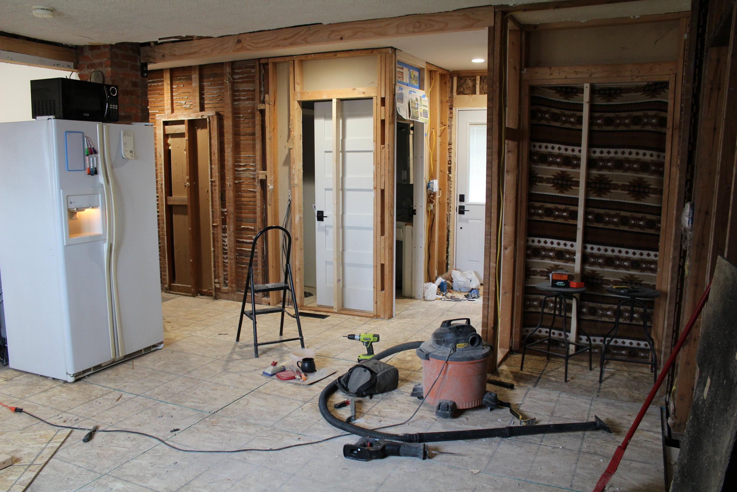 Kitchen and hallway - I spy our tiny microwave!