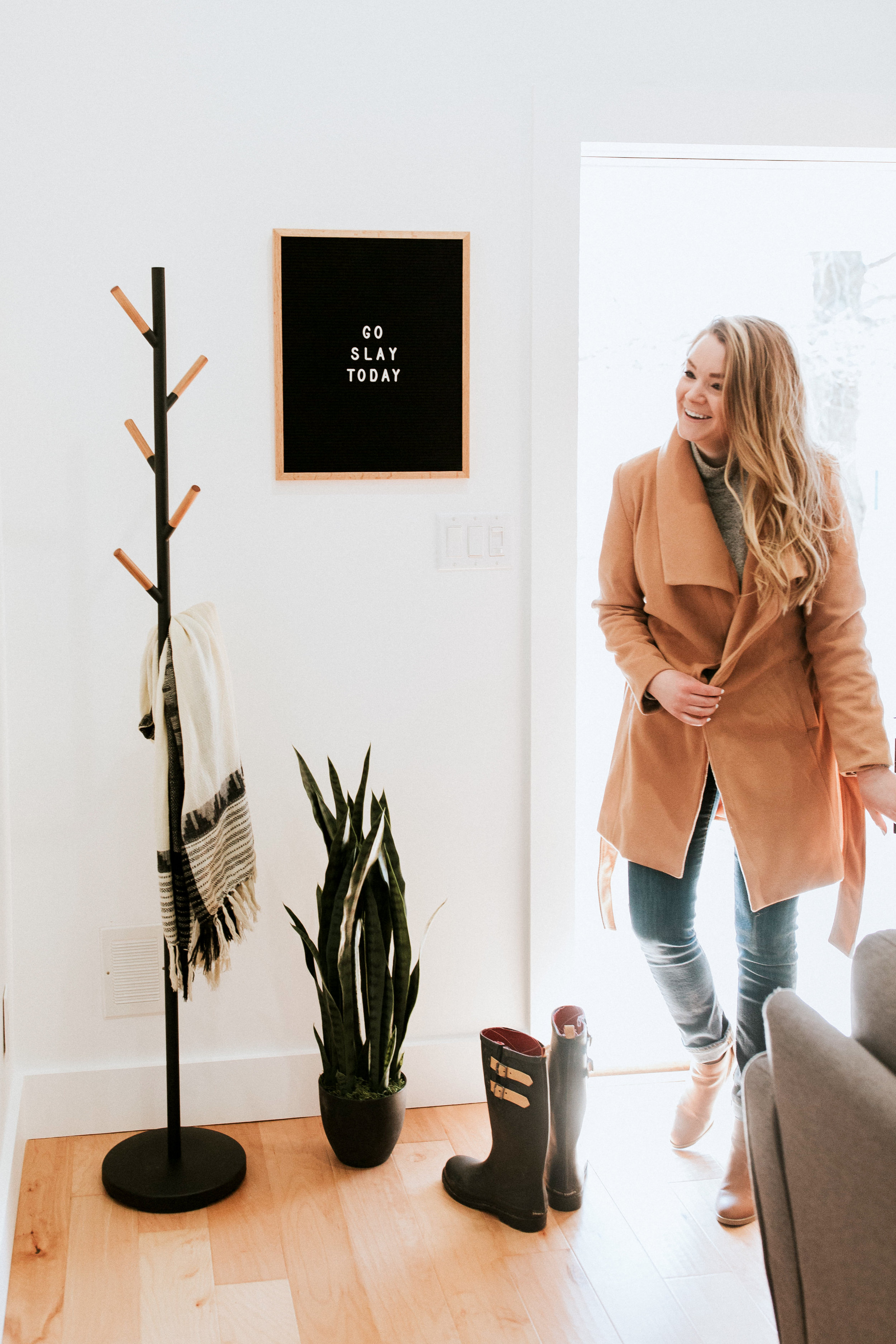 how we styled our entryway - modern minimal style inspiration featuring industrial coat rack, letterboard, and snake plant